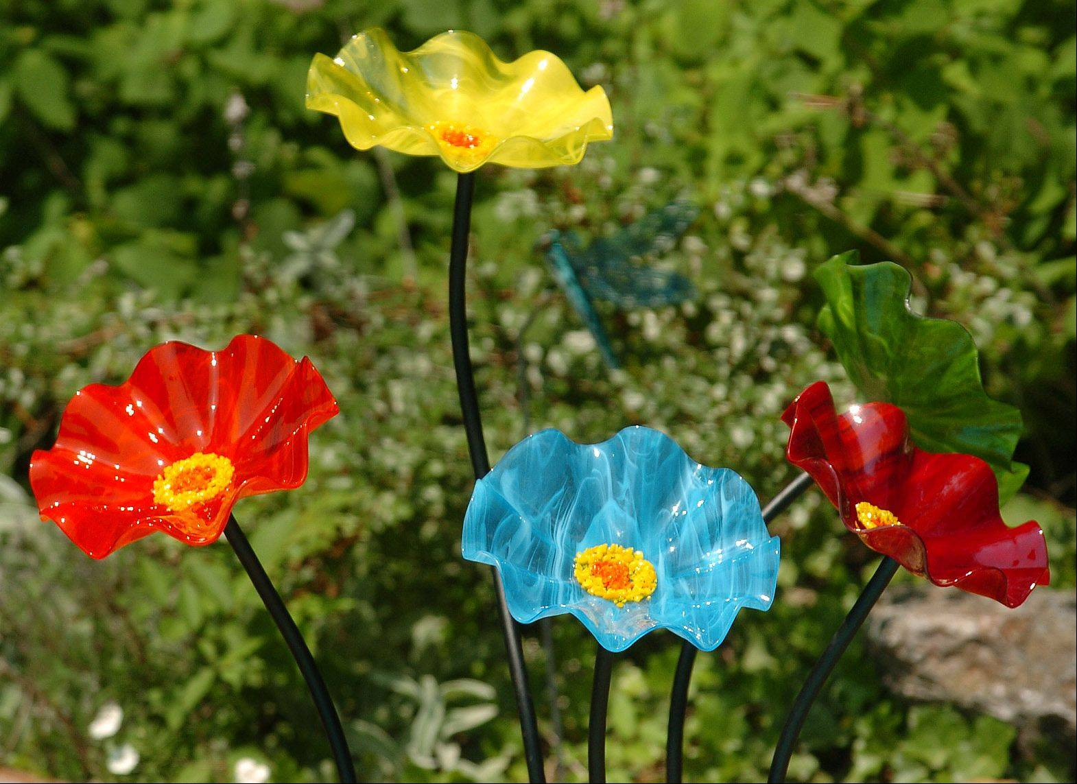 Amy Amdur uses a few brightly colored sculptures in her back yard, including these flowers.