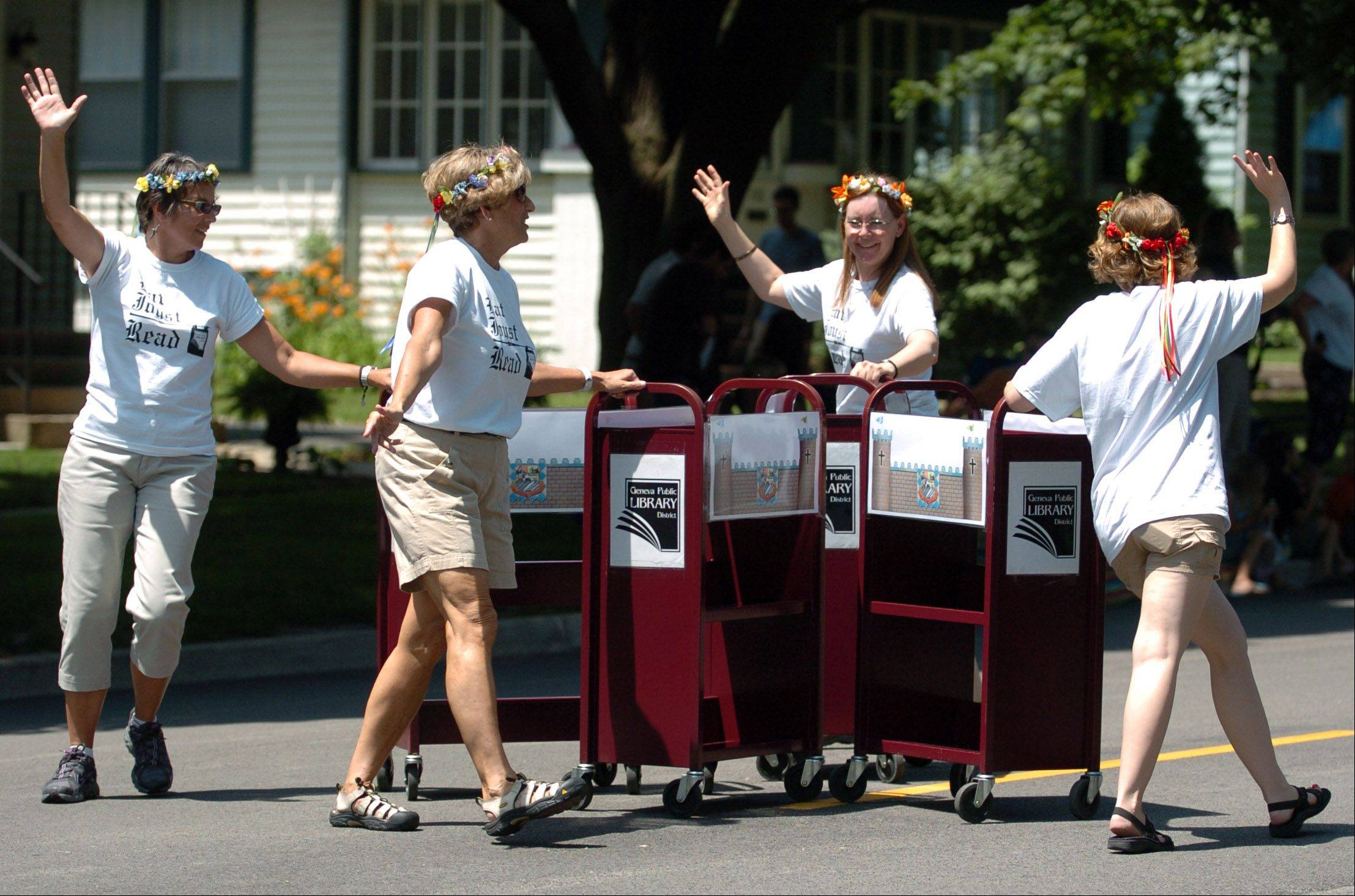 "The ""Geneva Public Library Book Cart Drill Team"" amused the crowds by pushing library book carts on Sunday at the Swedish Days Parade. The 62nd annual parade concluded the six-day festival run in Geneva."
