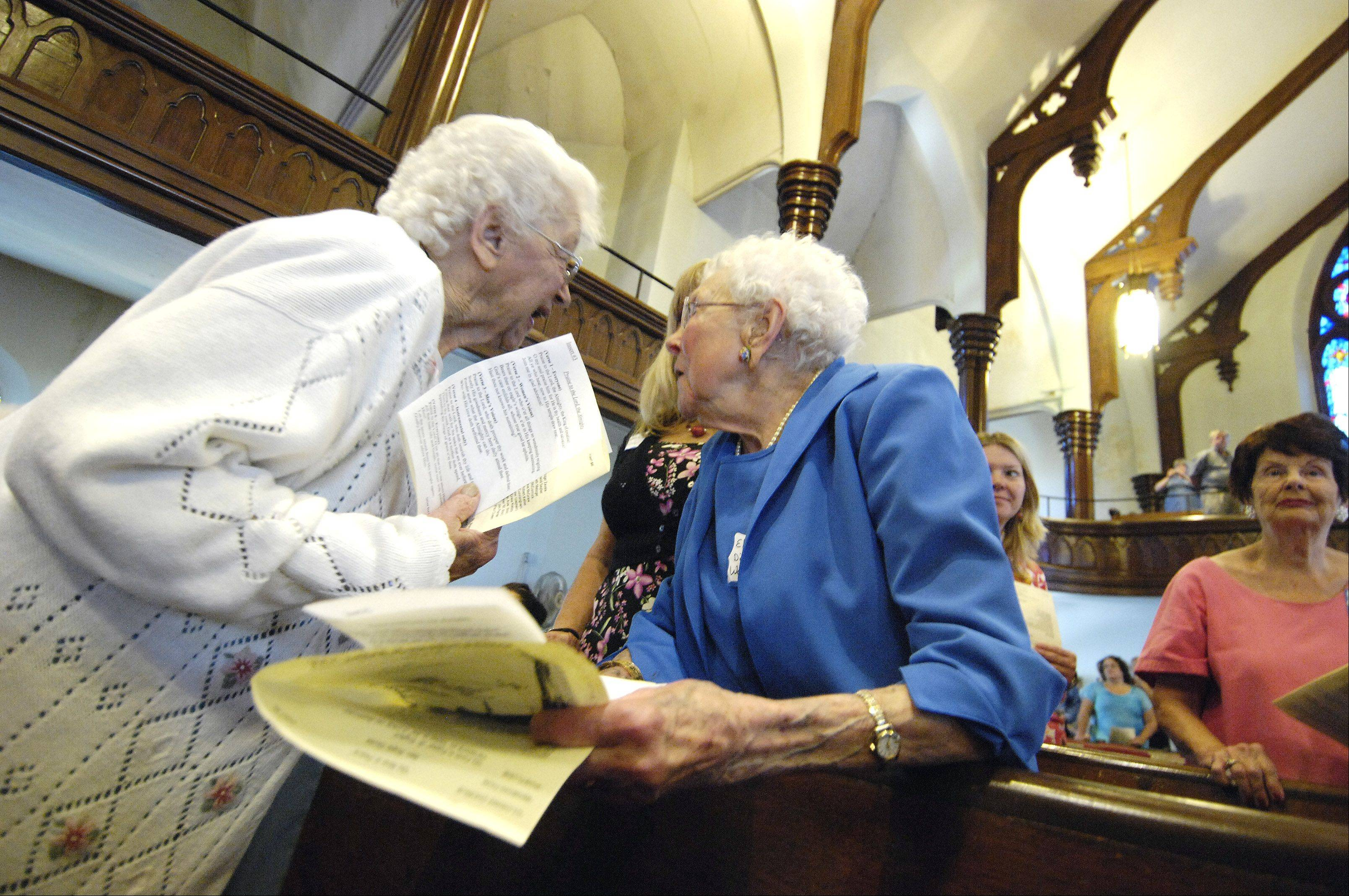 Longtime church members Edith Anderson and Elisie Ruth Dietrich Wagner, 98 years old, reminisce about Aurora's first church, First United Methodist. The church celebrated its final worship service Sunday after 174 years as a congregation.