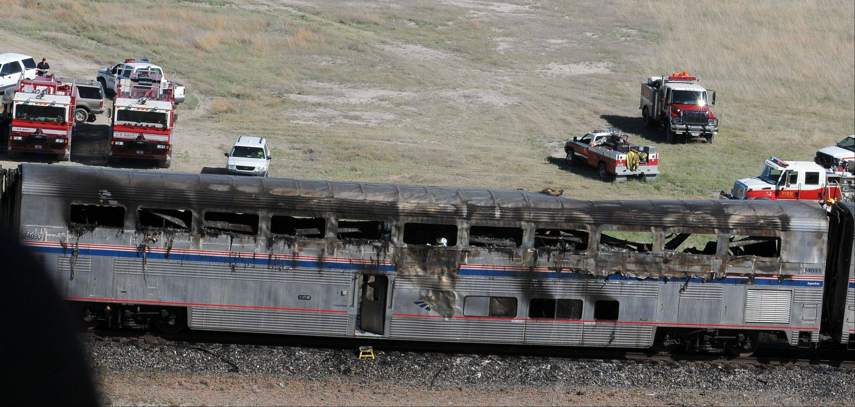 An Amtrak car is seen at the site of a collision between an Amtrak westbound train and a truck about 70 miles east of Reno, Nev.