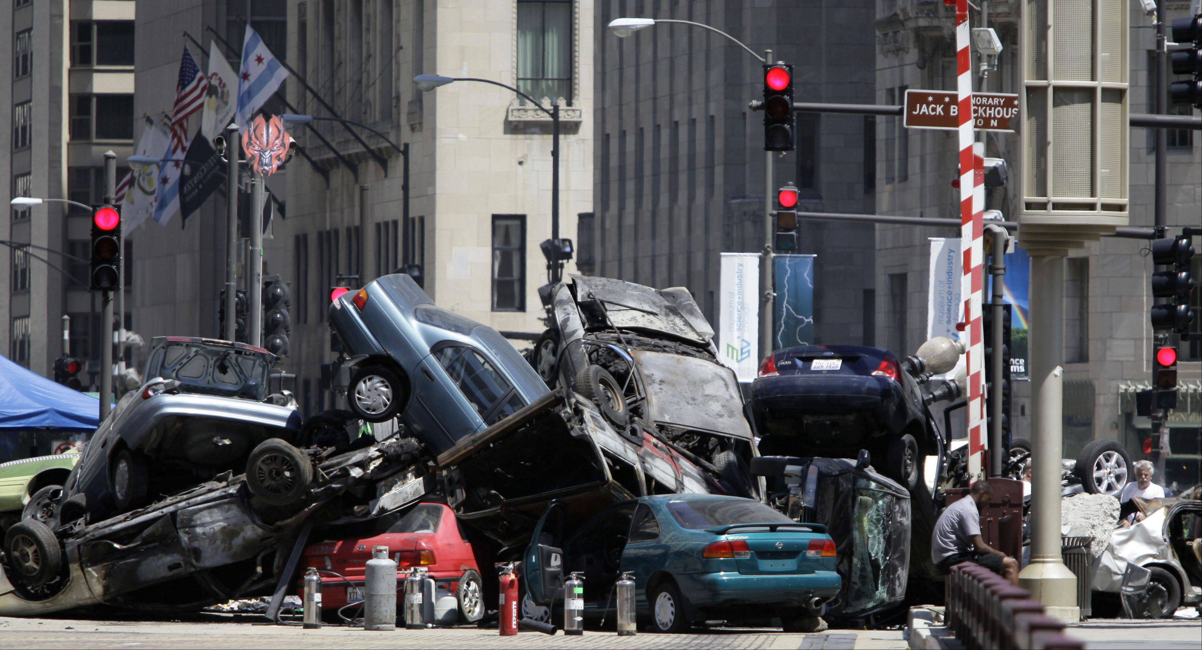 "Cars are seen piled up in a plaza along Michigan Avenue in downtown Chicago last summer during the filming of ""Transformers: Dark of the Moon."""