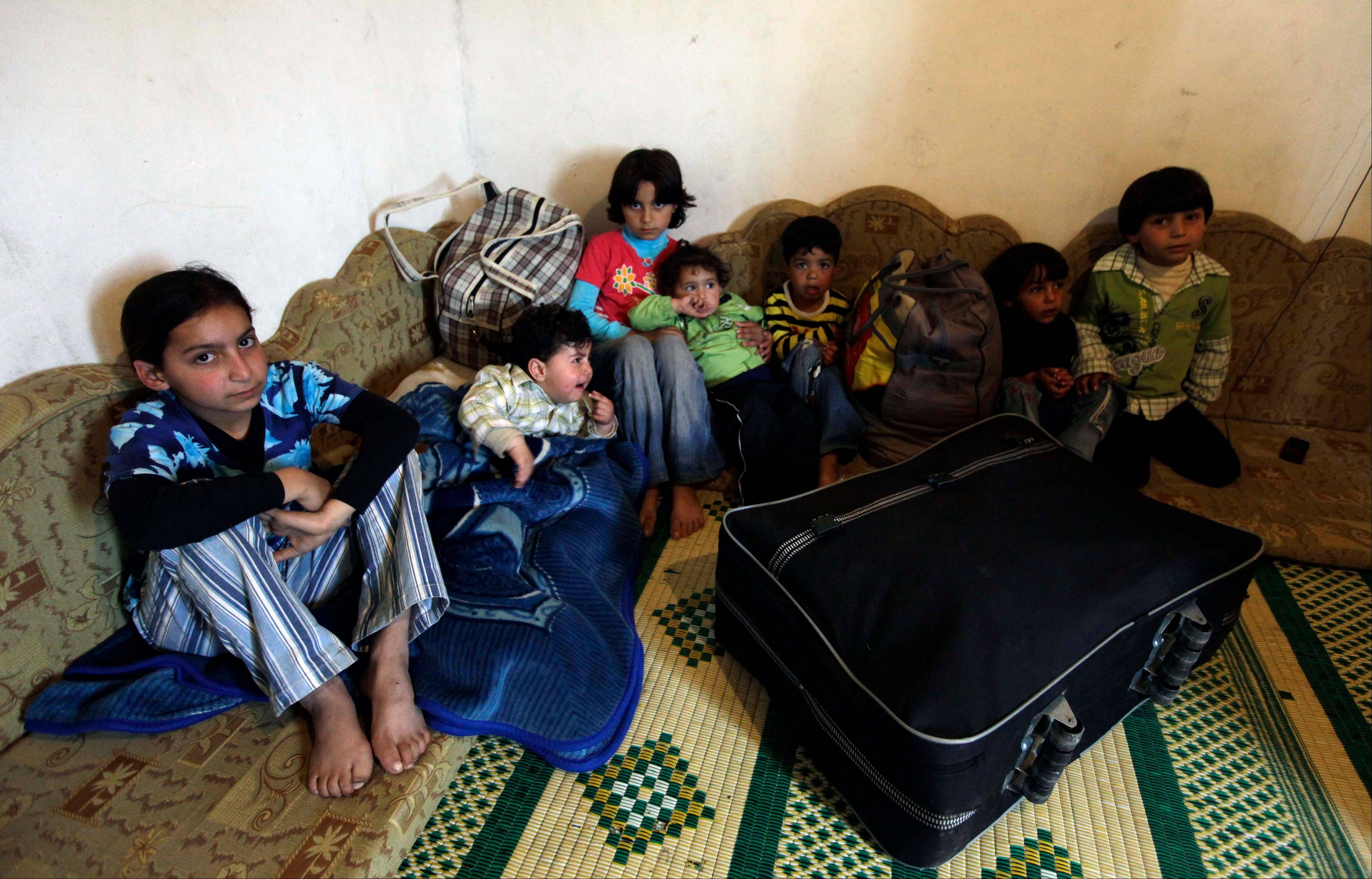 Syrian children gather at the house of their Lebanese relatives in April after fleeing the unrest in their country in the Wadi Khaled area, less than a mile from the Lebanon-Syria border, north of Lebanon.