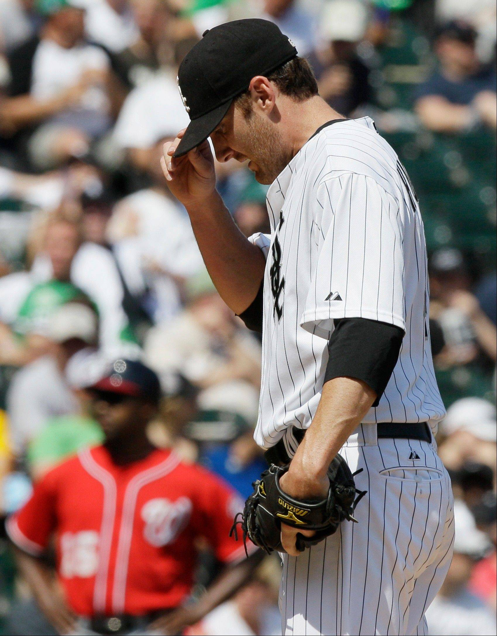White Sox starter Phil Humber reacts during the seventh inning when he allowed his only runs on a homer by the Nationals' Danny Espinosa.