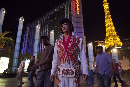 Rodrigo Gonsalez waits for tourists to pose with him for photos as he plays Elvis along The Strip, Thursday, June 23, 2011, in Las Vegas. Gonsalez, a welder by trade, has turned to street performing in the absence of construction jobs in the city. The number of celebrity impersonators crowding the Las Vegas Strip has grown in recent months, in part because the stalled economy has left many actors and performers in California and Las Vegas without a job. The casinos, however, are trying to stop them. The ACLU is demanding the city protect the performers, who are free to entertain on public sidewalks under the First Amendment so long as they don't charge for their services.
