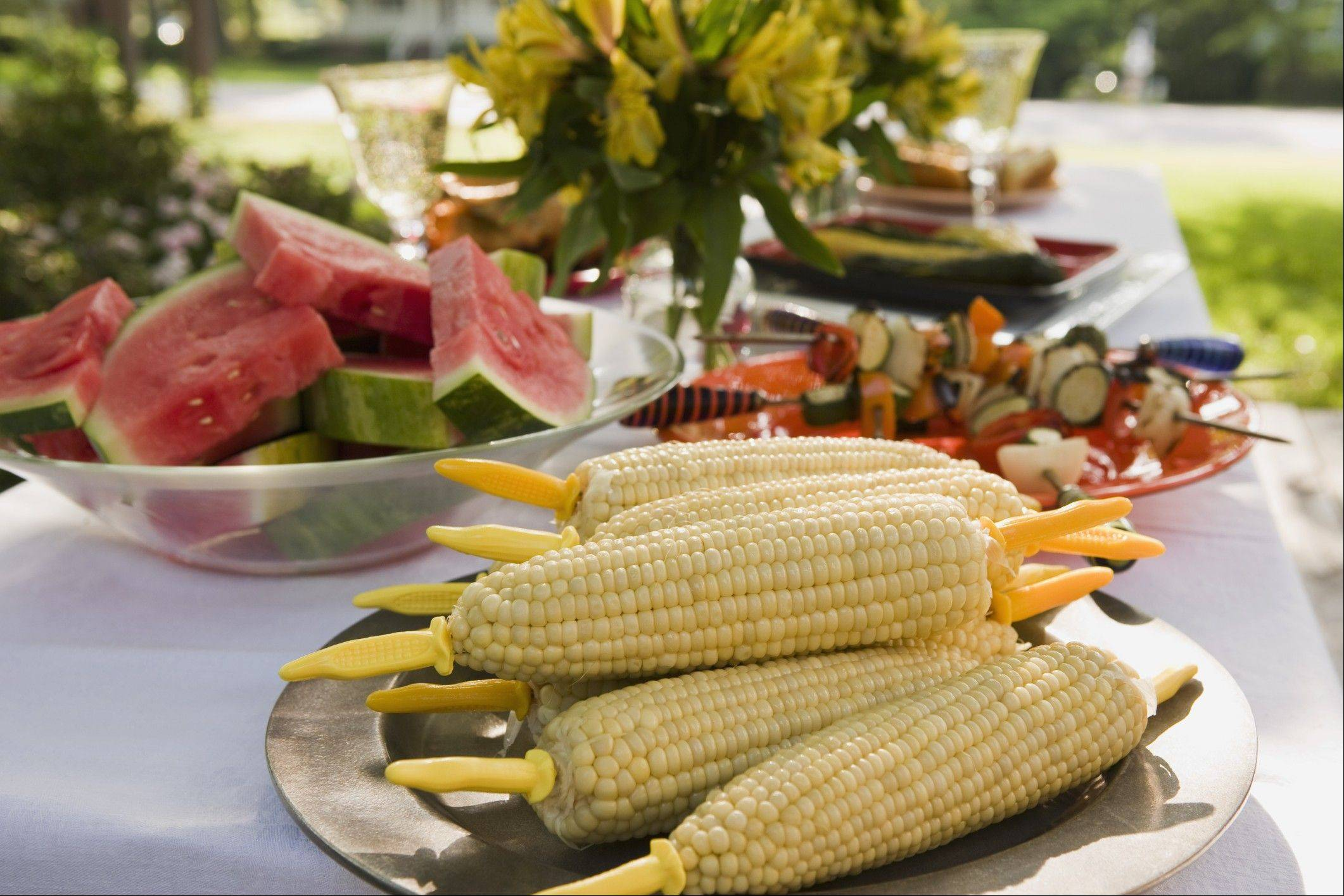Opt for healthier options like fruit, veggies and lean meats when you attend parties this summer.
