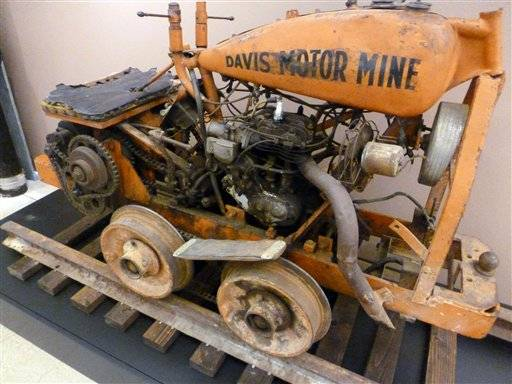 "In this June 7, 2011 photo is a mine vehicle, powered by a Harley motor, at the Harley-Davidson Museum in Milwaukee. The cart, which was created by a mine worker in northern California around 1926, is part of a new exhibit, ""Collection X: Weird, Wild Wonders of the Harley-Davidson Museum,"" which runs through Aug. 21."