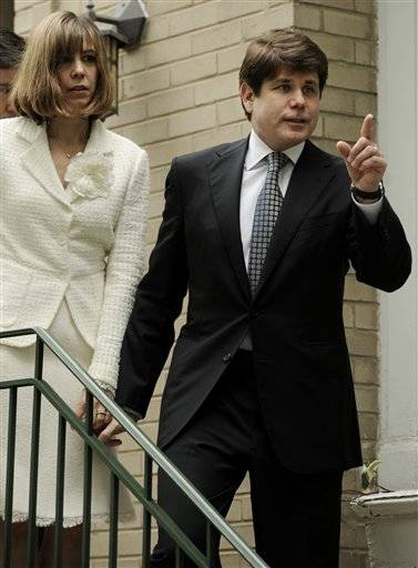 Former Illinois Gov. Rod Blagojevich and his wife, Patti, leavetheir home for the courthouse.