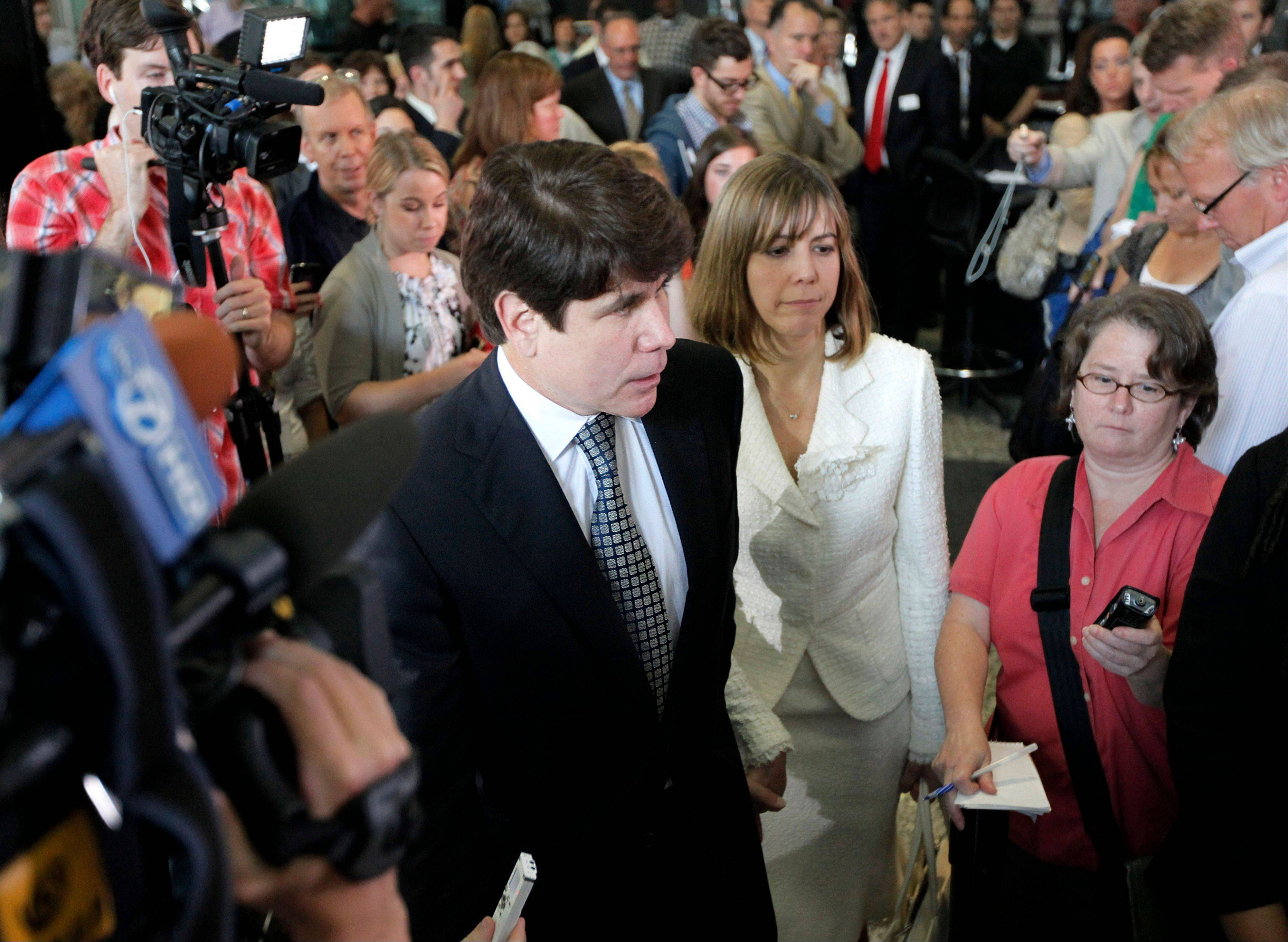 Former Illinois Gov. Rod Blagojevich comes to speak to the media with his wife Patti at the Federal Courthouse Monday, June 27, 2011 in Chicago. Blagojevich has been convicted of 17 of the 20 charges against him.