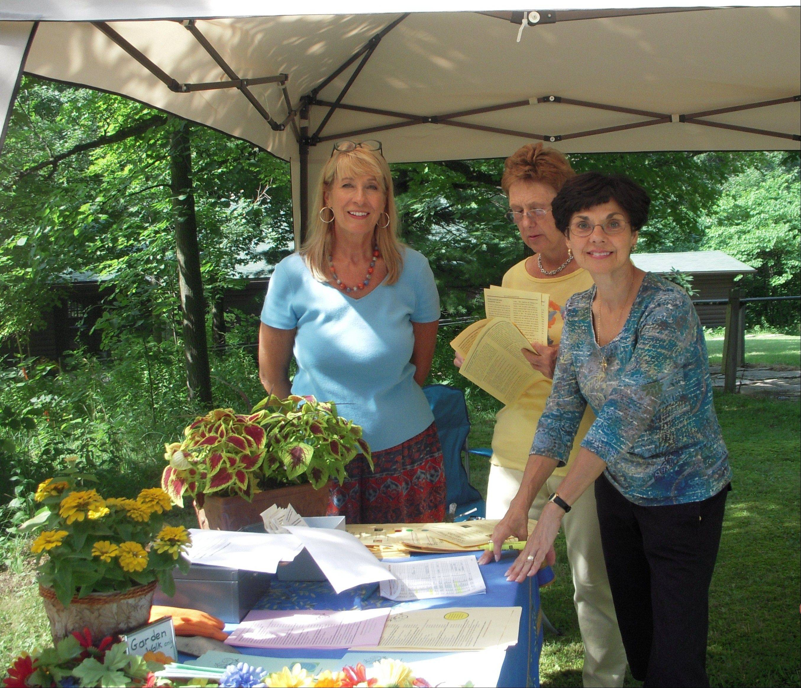 Long Grove-Kildeer Garden Club Garden Walk committee members Ivy Guarise, LaRayne Scharm and Barb D�Ambrosio set up the greeting station for the July 11 Garden Walk through four area gardens.