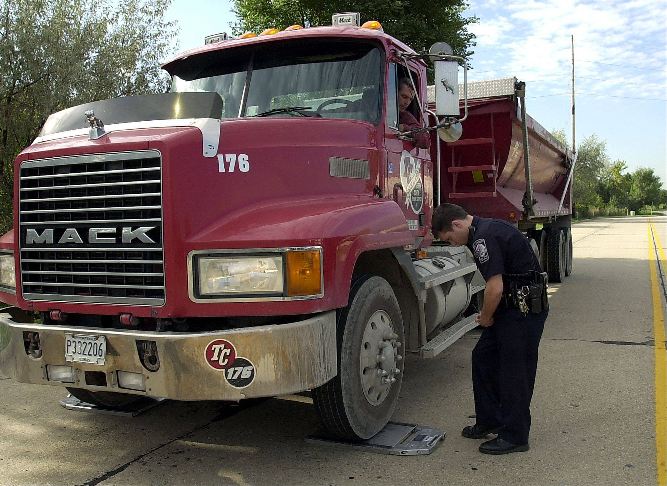 Some suburban police have serious reservations about legislation pending in Congress that would raise truck weight limits on interstate highways from 80,000 pounds to 97,000 pounds with an additional axle. Supporters say it would reduce trips, thereby saving gas and reducing traffic, but opponents argue it would be a safety hazard and worsen roadways.