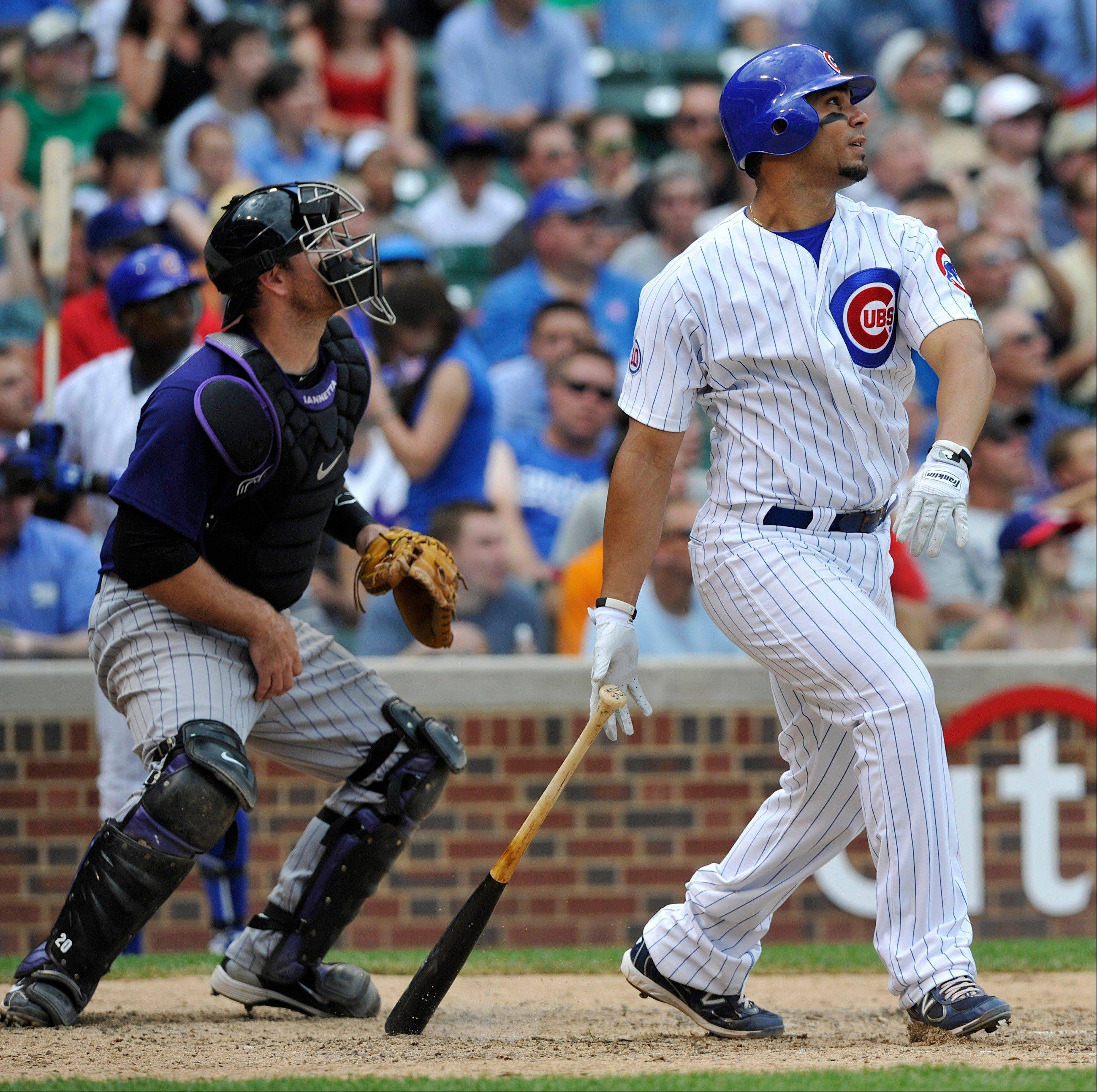 With Rockies catcher Chris Iannetta looking on, Carlos Pena watches his 2-run home run during the fifth inning of the Cubs' victory Monday at Wrigley Field. Pena had 2 homers on the day and now has 16 for the season.