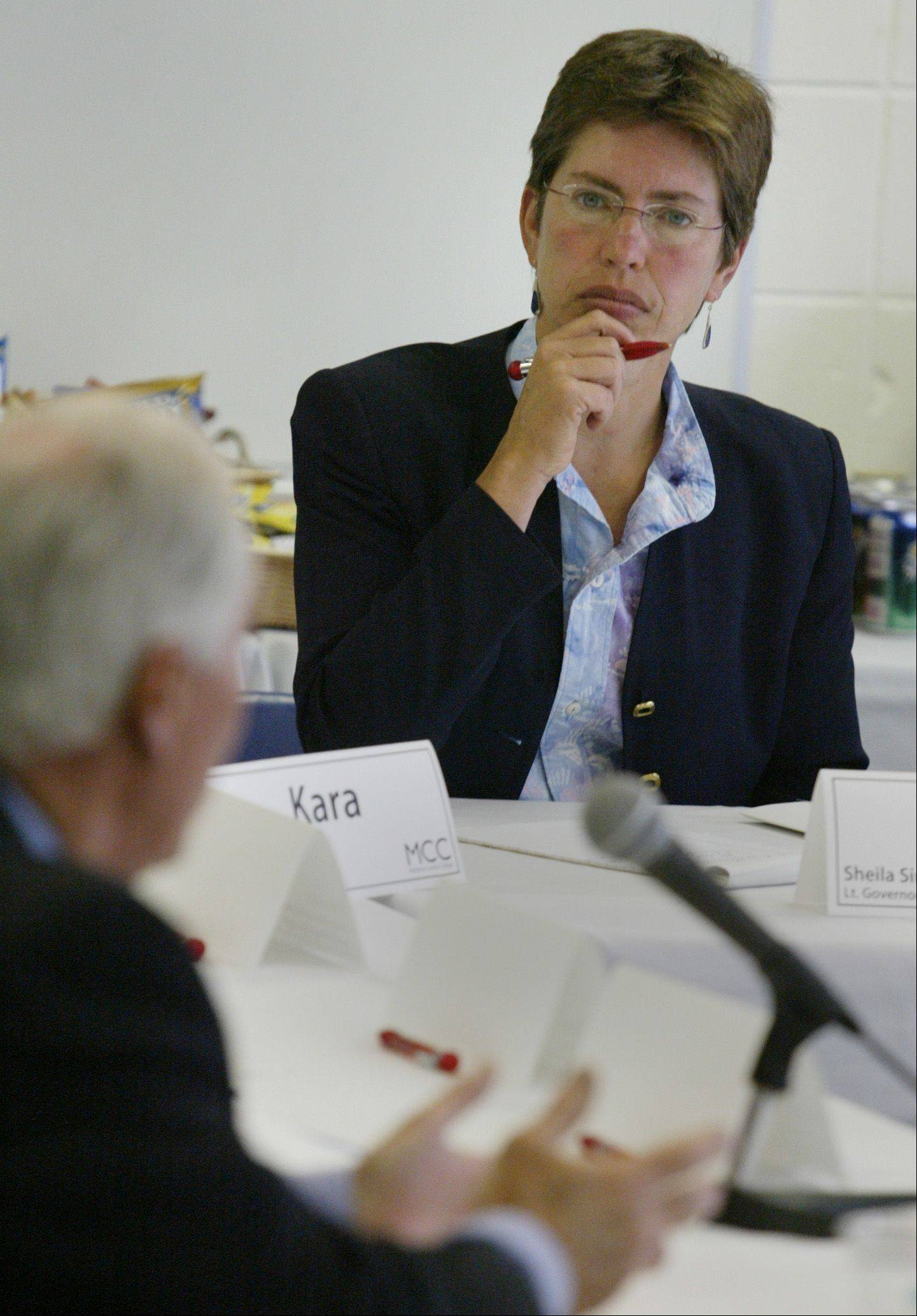 Lt. Gov. Sheila Simon listens to Tony Capalbo speak Monday during a meeting with faculty, staff and students.