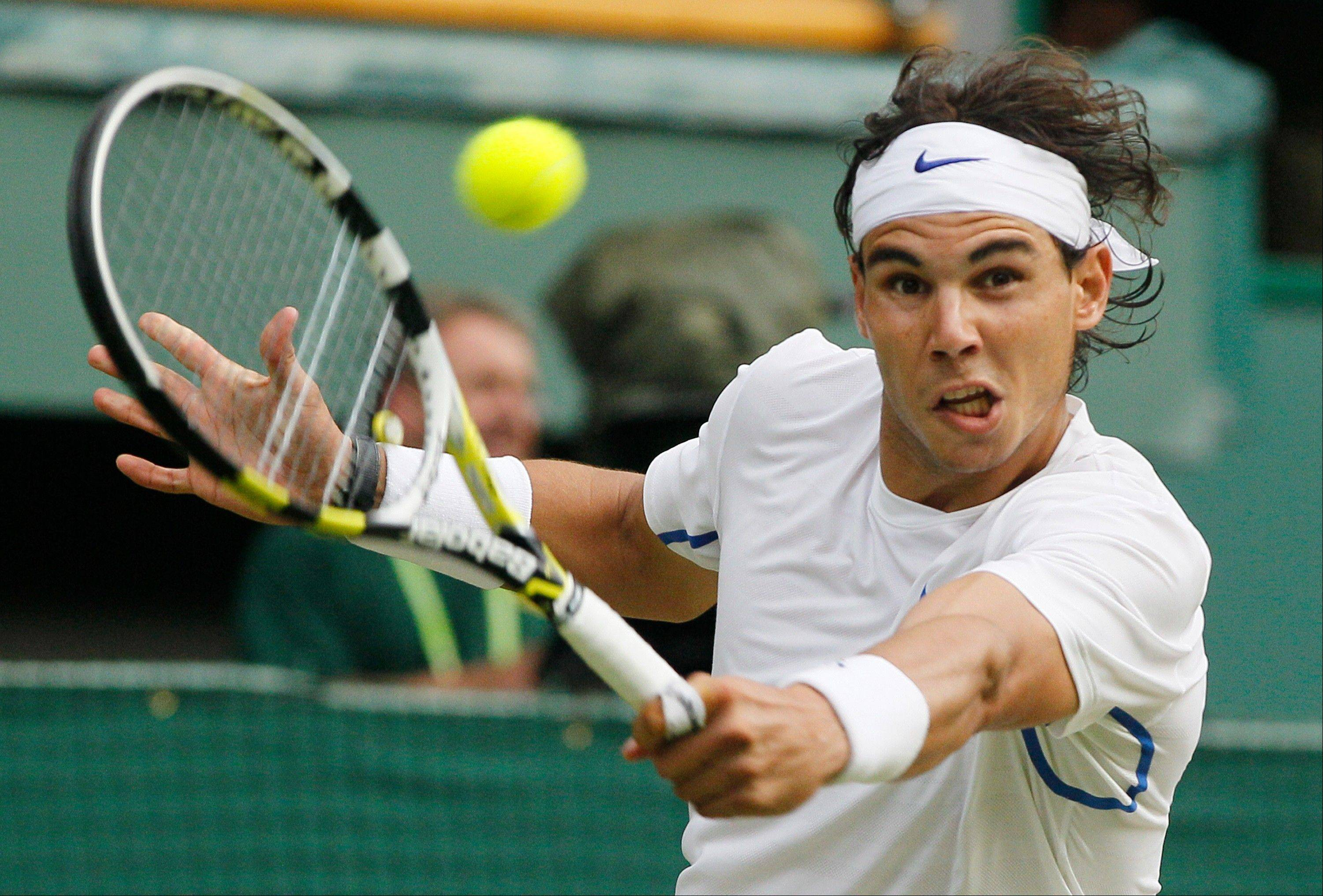 Spain's Rafael Nadal returns the ball to Argentina's Juan Martin Del Potro at Wimbledon on Monday.