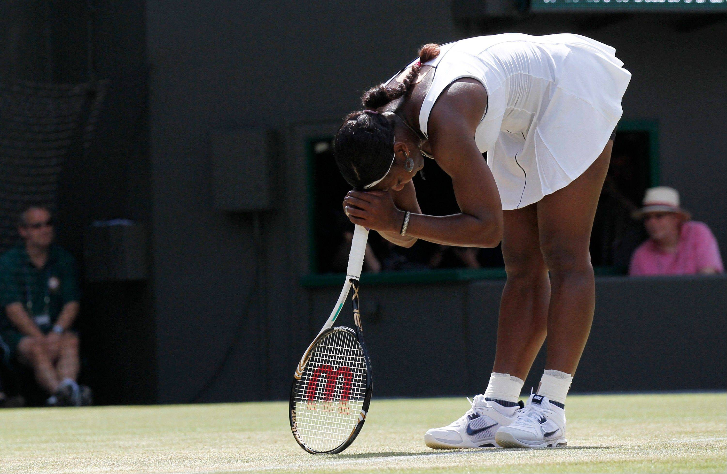 Serena Williams reacts during her loss against France's Marion Bartoli at Wimbledon on Monday.