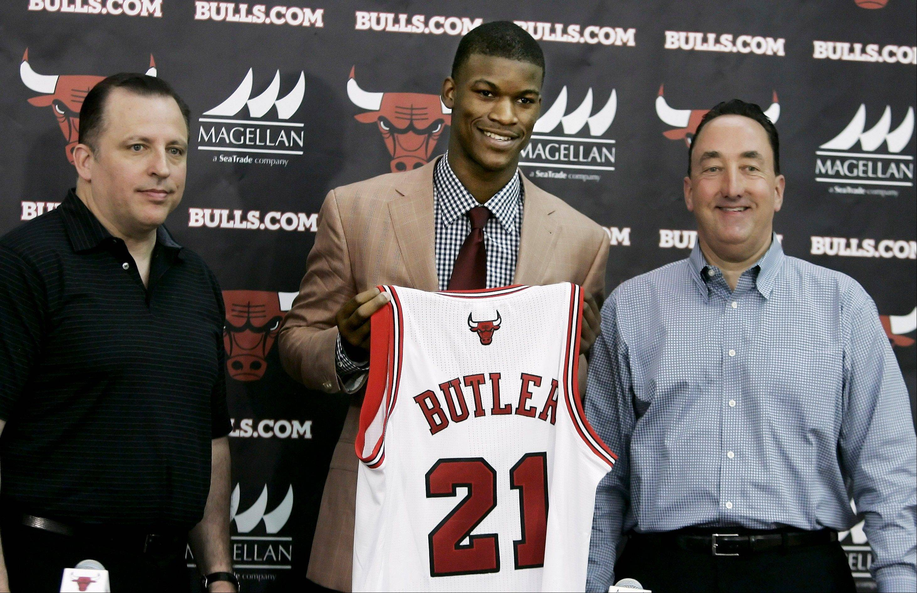 Jimmy Butler is introduced to the media Monday by Bulls general manager Gar Forman, right, and head coach Tom Thibodeau at the Berto Center in Deerfield.,