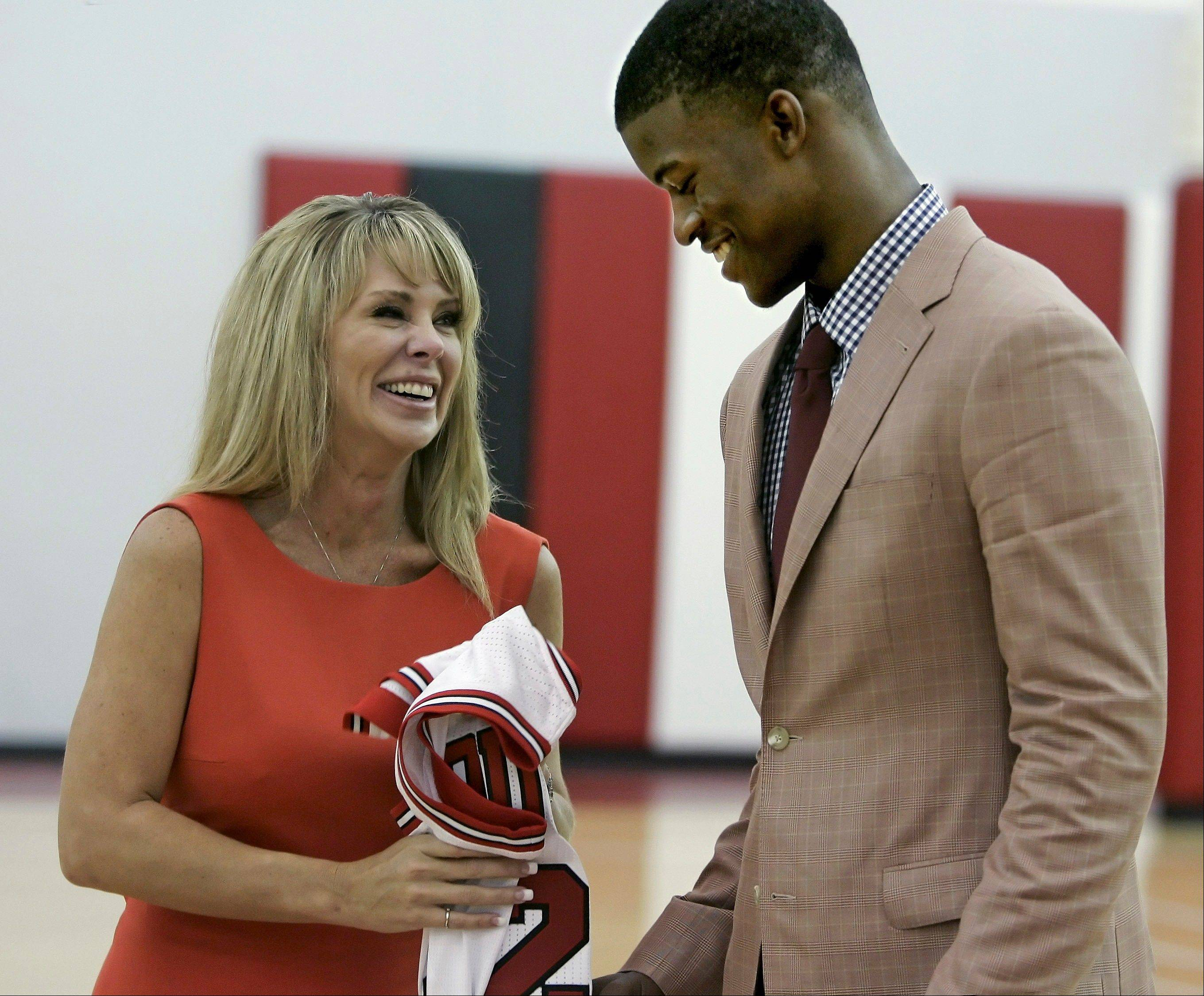 Chicago Bulls first-round draft pick Jimmy Butler from Marquette laughs with his mother, Michelle Lambert, after he was introduced by the Bulls Monday at the Berto Center.