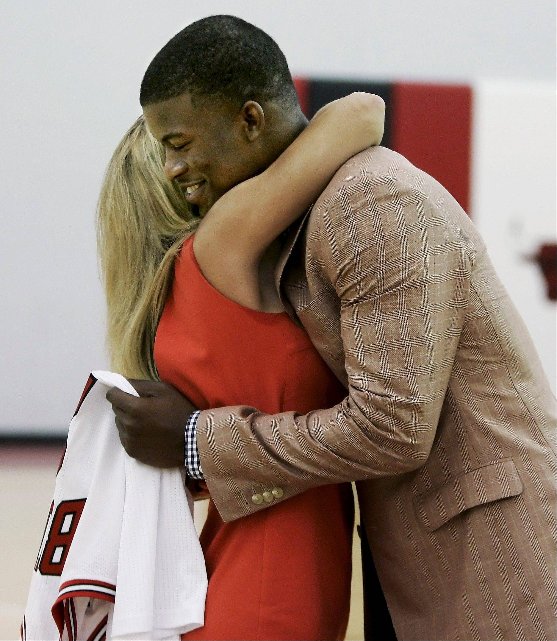 Chicago Bulls first-round draft pick Jimmy Butler from Marquette hugs his mother, Michelle Lambert, after he was introduced by the Bulls Monday at the Berto Center.