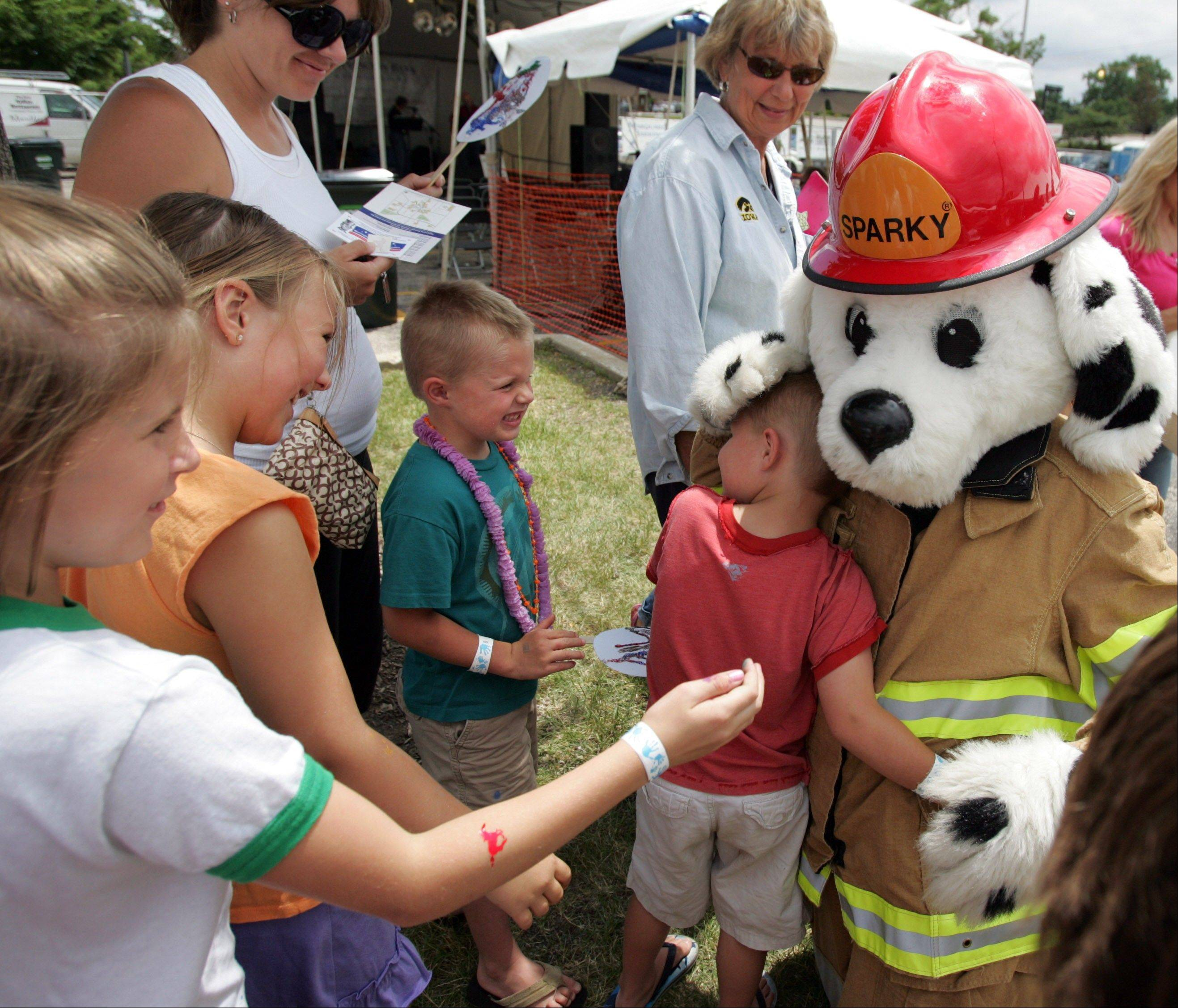 Sparky, with the Barrington Fire Department, makes his way around the fest, hugging and high-fiving kids.