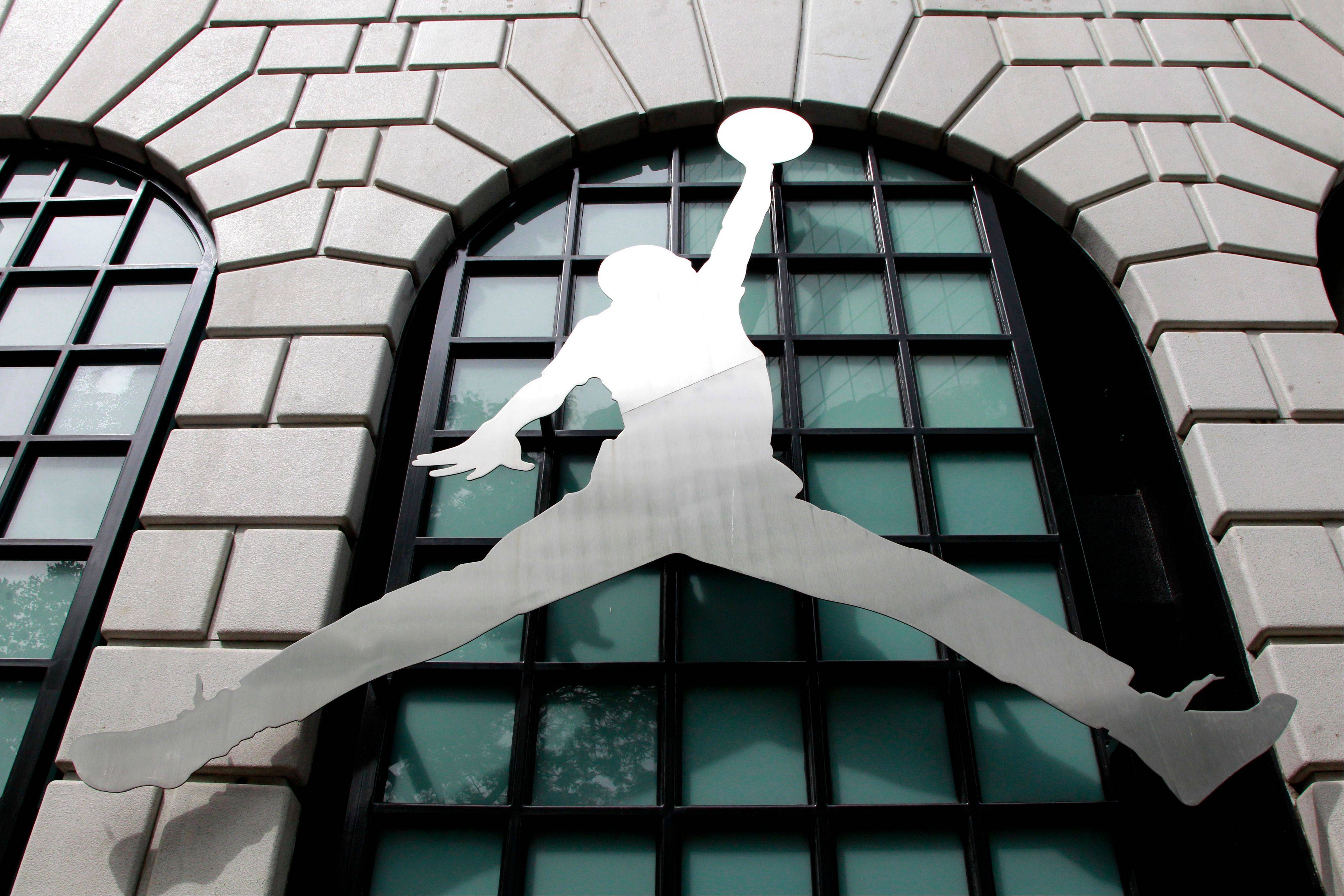 The Nike Air Jordan logo is shown in front of the Niketown store in Portland, Ore., Monday. Nike Inc.'s fourth-quarter net profit rose 14 percent to beat expectations as the company's sales improved around the globe.