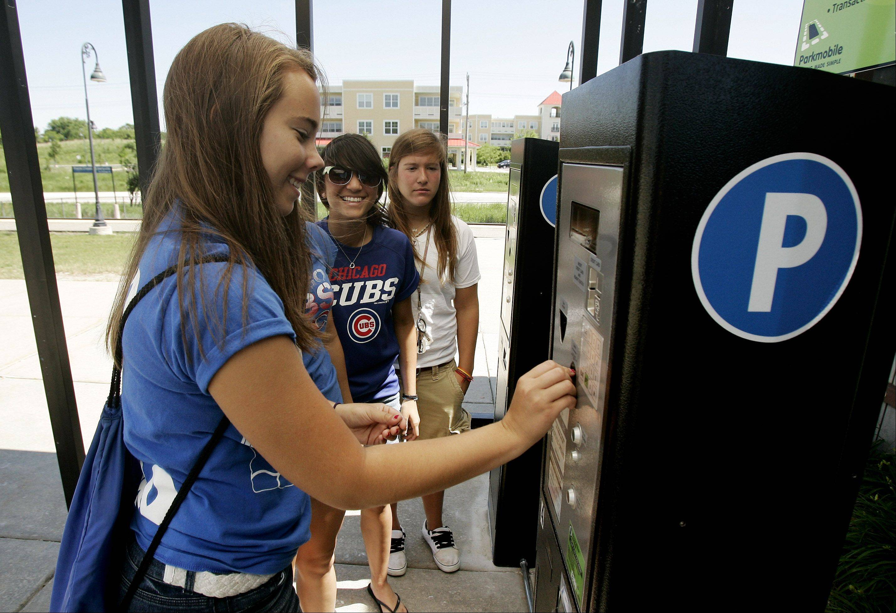 Megan Byrd, 18, of Gurnee, was among the commuters Tuesday to use the newly installed pay stations at the Prairie Crossing commuter station in Libertyville.