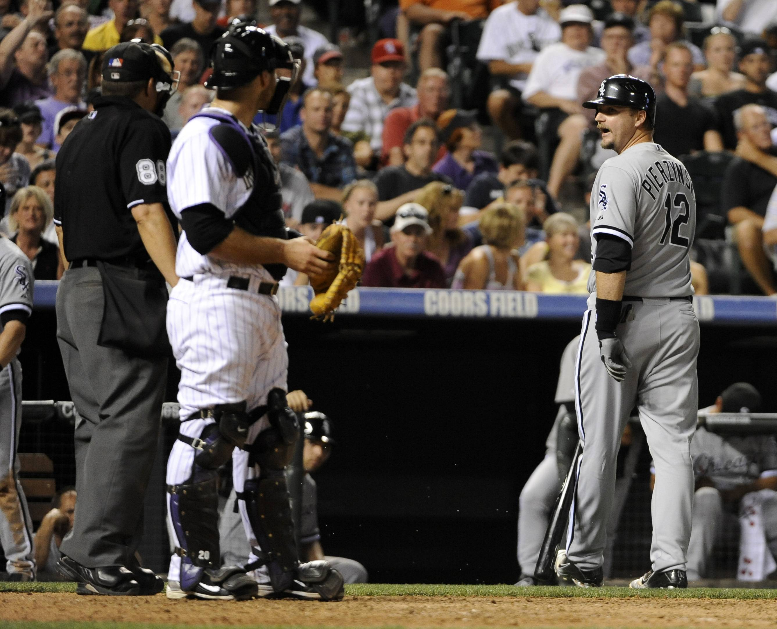 A.J. Pierzynski argues with home plate umpire Doug Eddings as Colorado Rockies catcher Chris Iannetta looks on during the ninth inning Tuesday night at Coors Field.