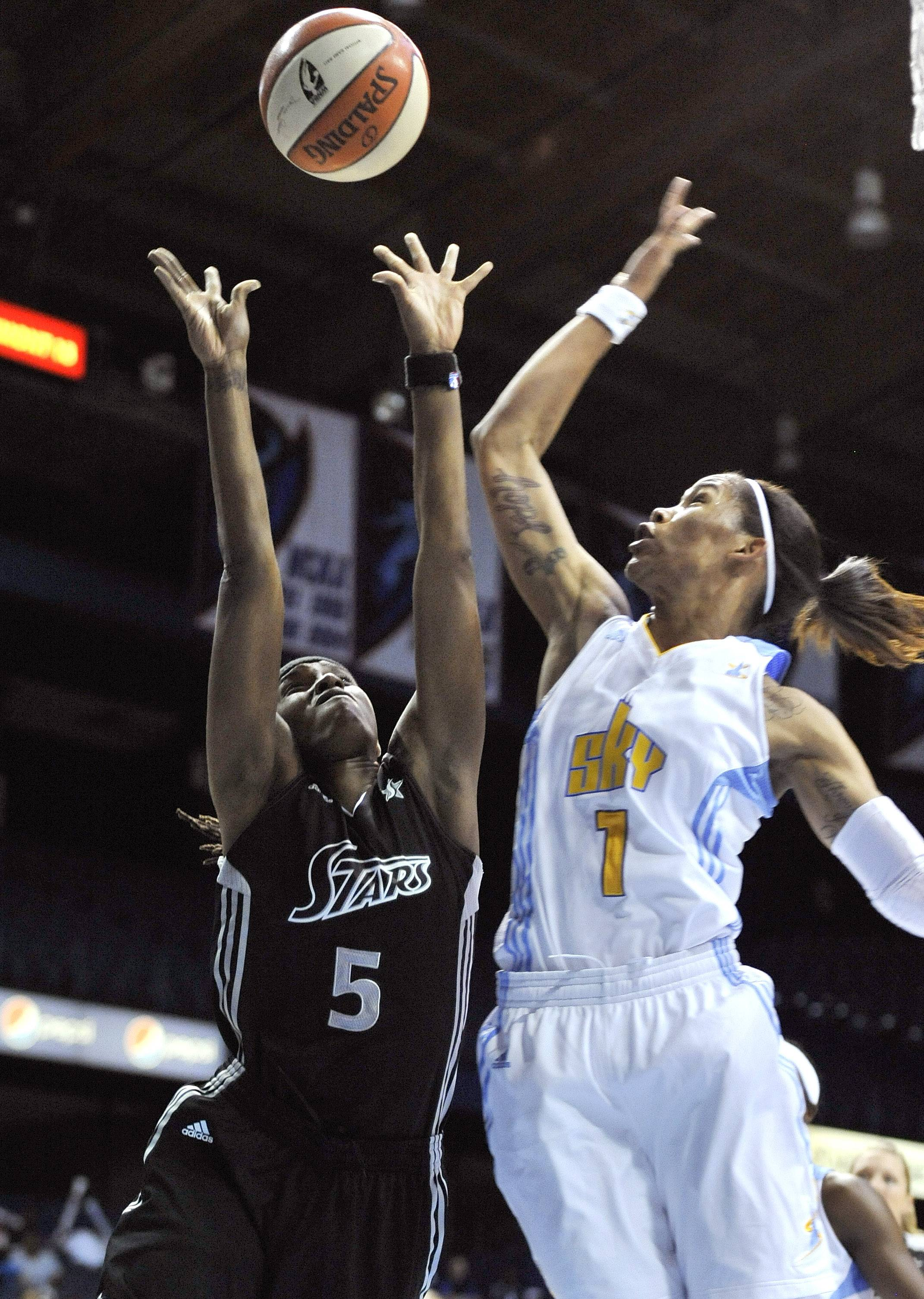 Tamera Young fouls San Antonio Silver Stars guard Roneeka Hodges as she goes up for a shot during the second quarter Tuesday at Allstate Arena.