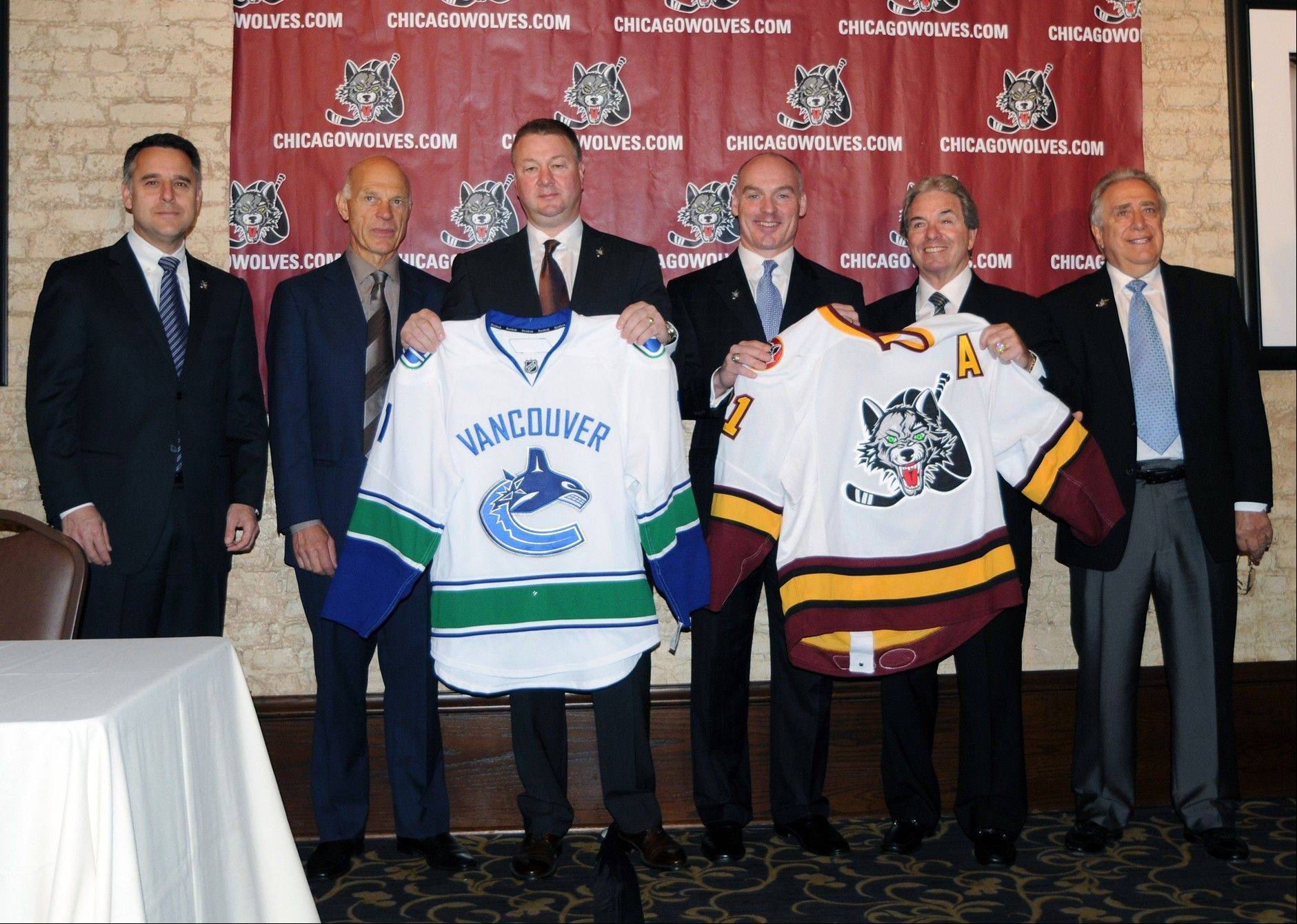 The new partnership between the Chicago Wolves and Vancouver Canucks includes, from left, Vancouver vice president of hockey operations Laurence Gilman, Vancouver vice president of player personnel Lorne Henning, Vancouver president and general manager Mike Gillis, Wolves general manager Wendell Young, Wolves vice chairman Buddy Meyers, Wolves senior advisor and director of hockey pperations Gene Ubriaco.