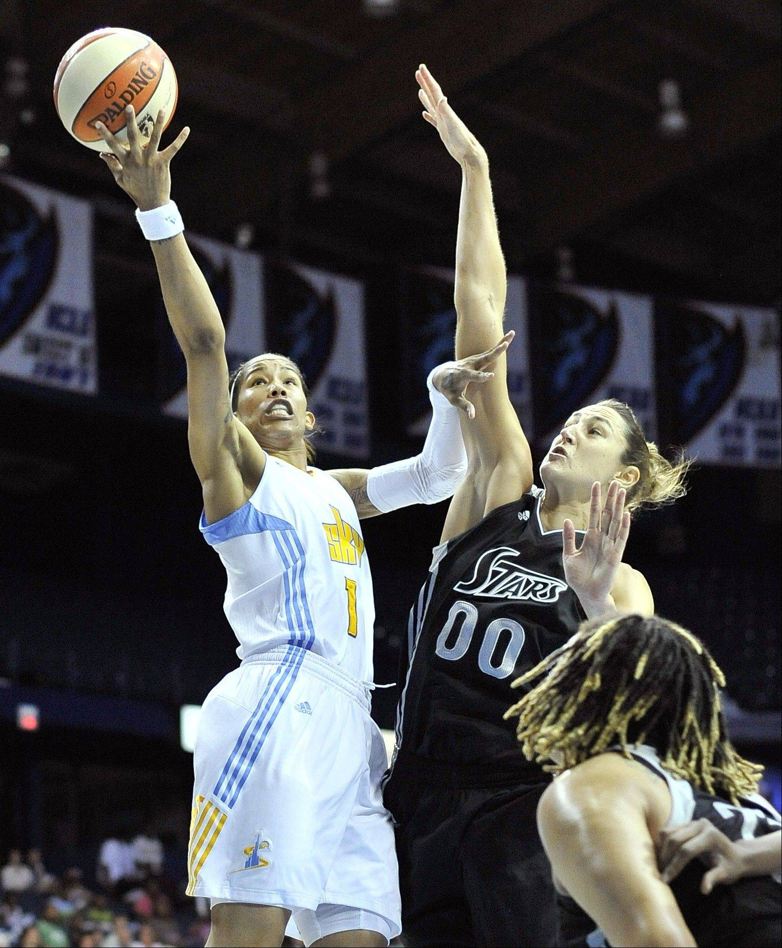 The Sky's Tamera Young fires up a shot against Silver Stars defender Ruth Riley on Tuesday at the Allstate Arena.