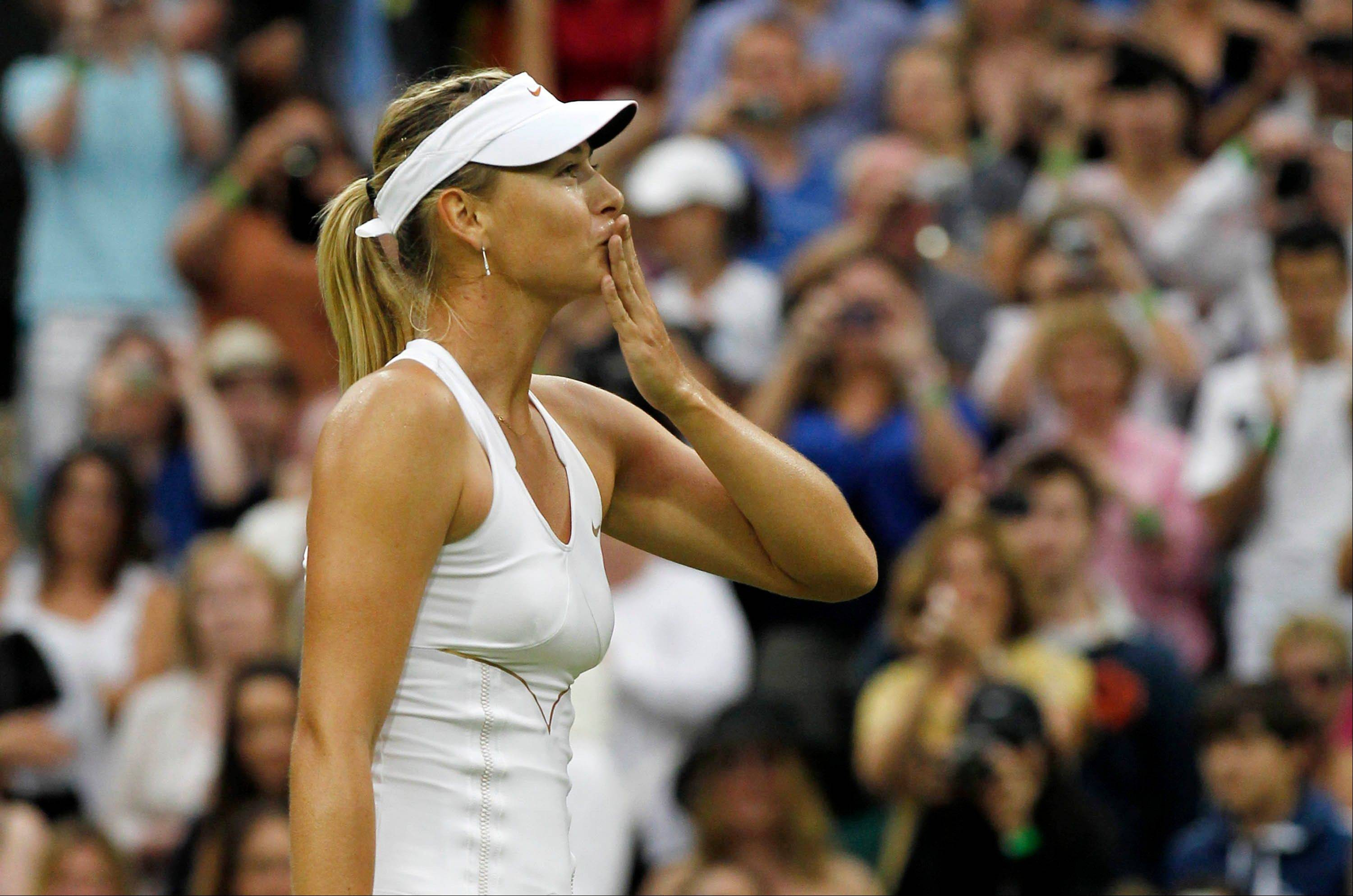 Russia's Maria Sharapova blows kisses to the crowd after defeating Slovakia's Dominika Cibulkova in their match Tuesday at the All England Lawn Tennis Championships at Wimbledon.