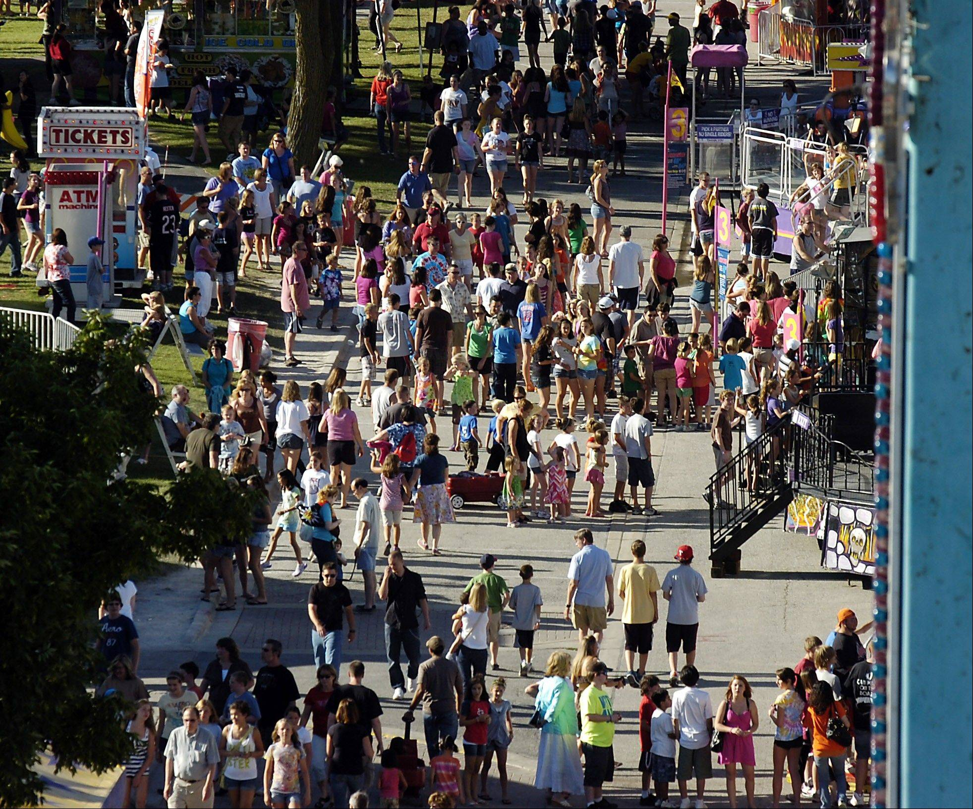 The throngs invade Frontier Days at one recent festival.
