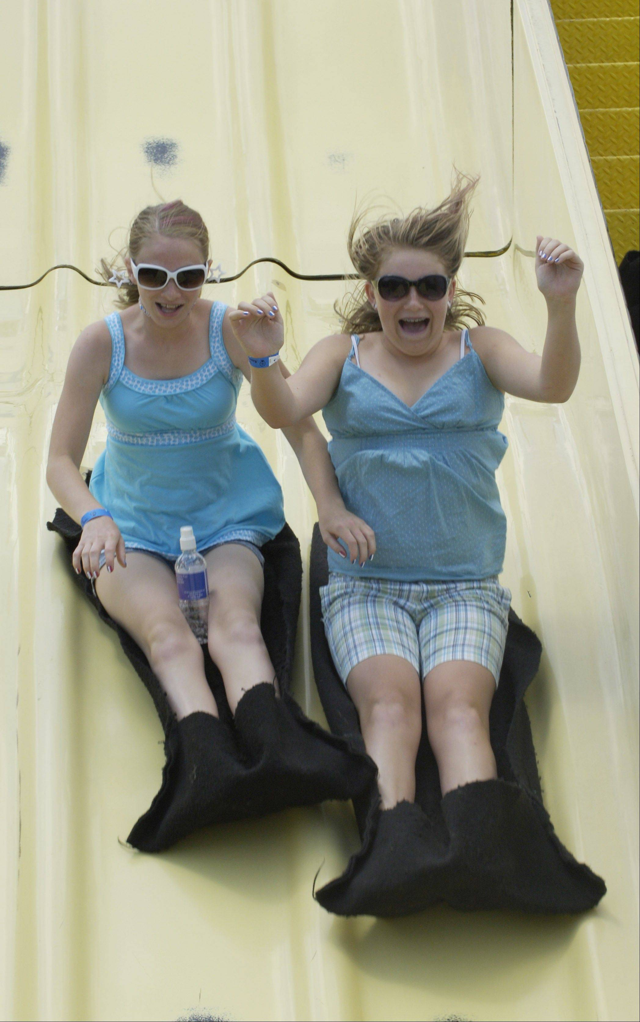 Two kids fly down the slide at a previous year's Hometown festival.