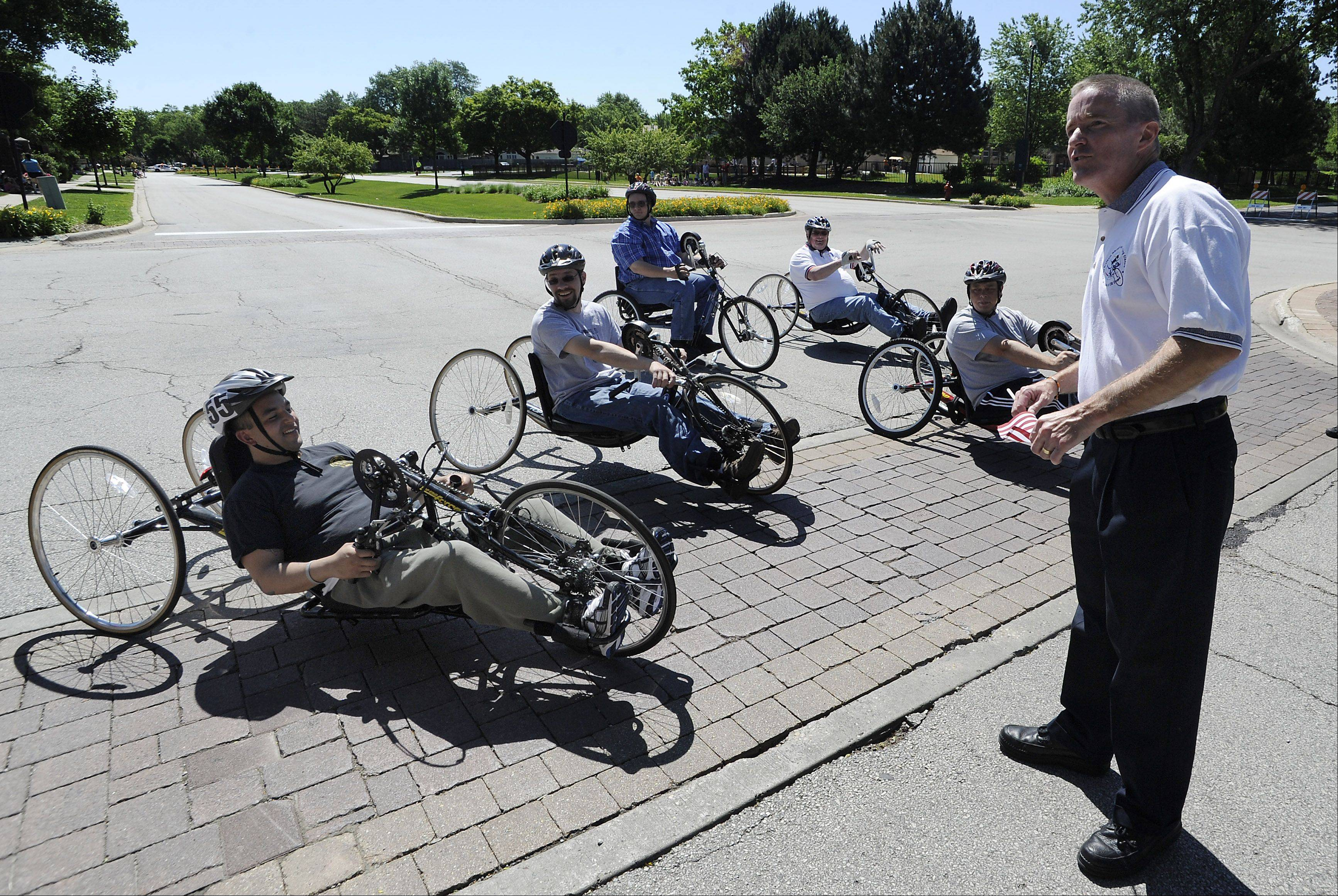 Elk Grove Village Mayor Craig Johnson gets ready to start a mini-race Tuesday to promote disabled athletes who will participate in an adaptive handcycle race as part of the upcoming Tour of Elk Grove.
