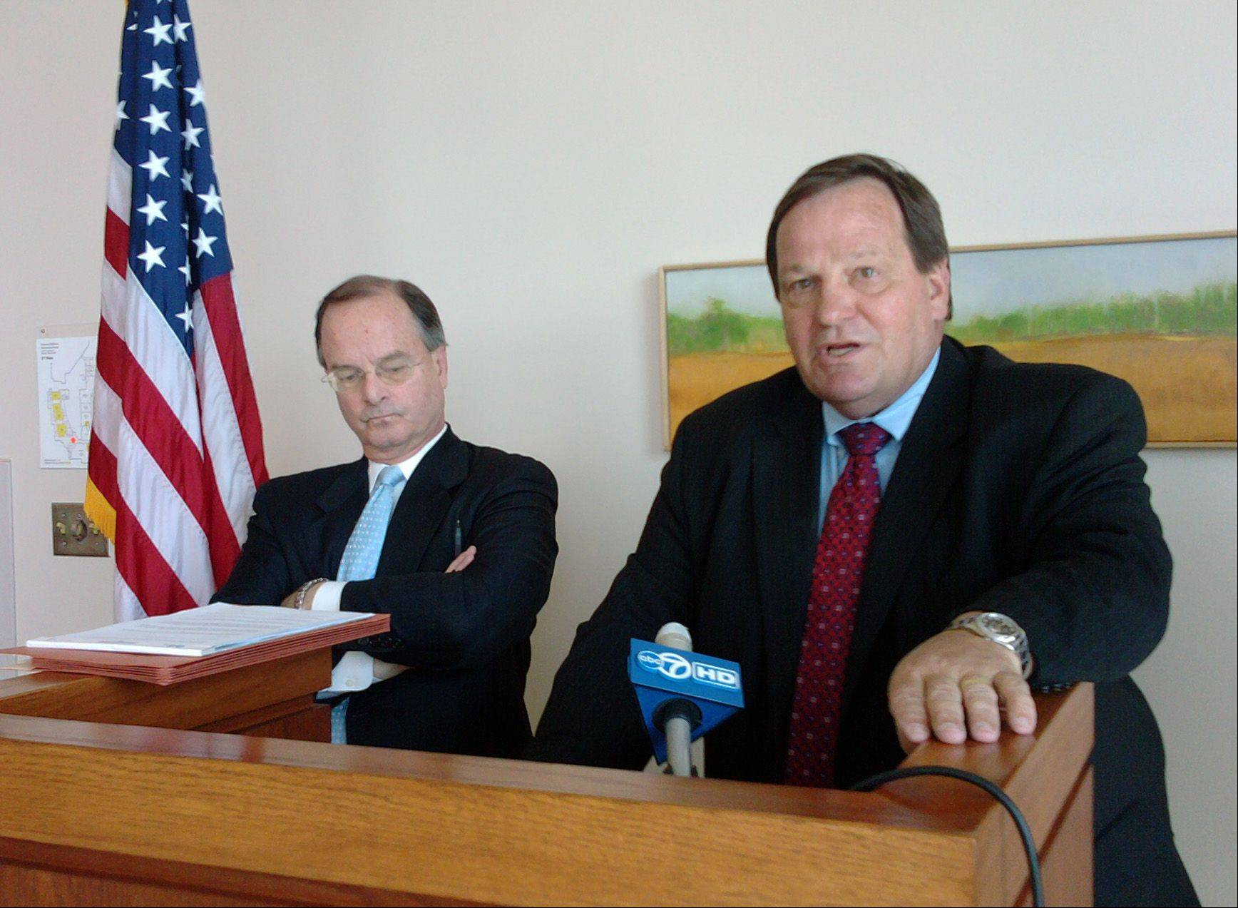 Retired Lake County Circuit Judge Henry Tonigan III, right, addressed media while working as a special prosecutor in a recent case against McHenry County State's Attorney Louis Bianchi.