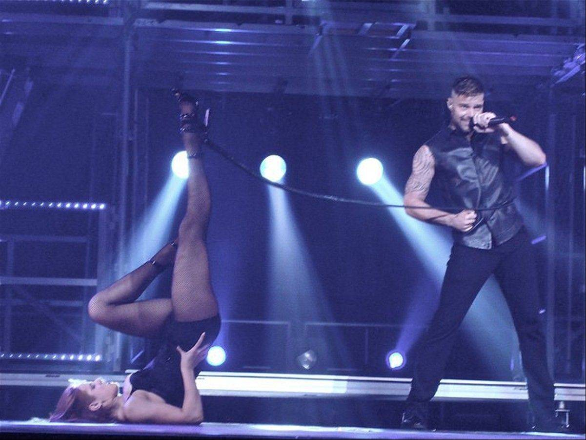 Amy Lynn Miles, 22, a native of Bensenville, dances onstage with Ricky Martin during his world tour.