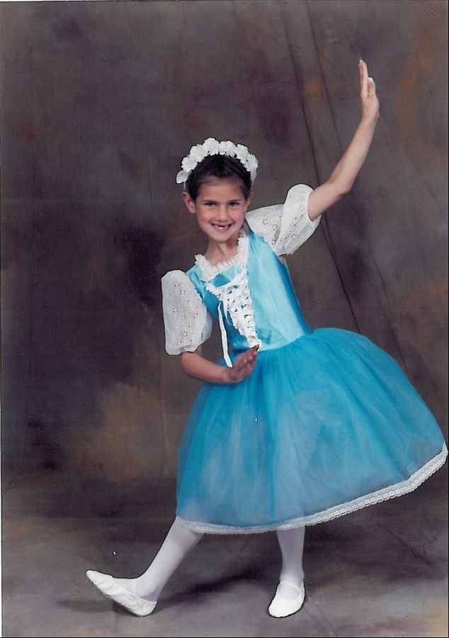 Bensenville native Amy Lynn Miles, at age 7, poses in her costume before a dance recital. She is now traveling the world as a dancer in Ricky Martin's concert tour.