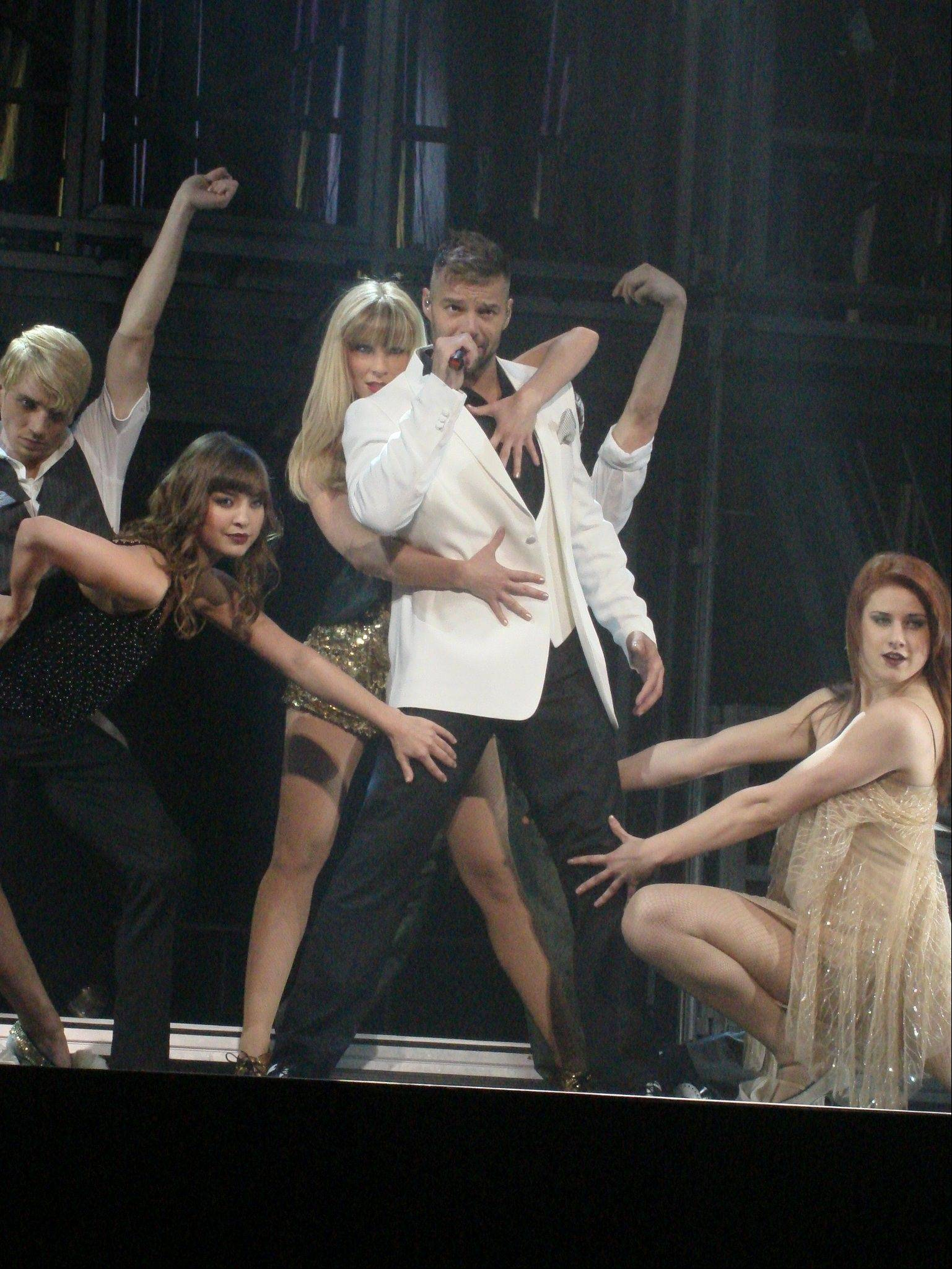 Bensenville native Amy Lynn Miles, far right, dances on stage with Ricky Martin during his world tour.