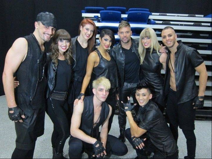 Bensenville native Amy Lynn Miles, third from left, poses with pop superstar Ricky Martin and the other tour dancers.