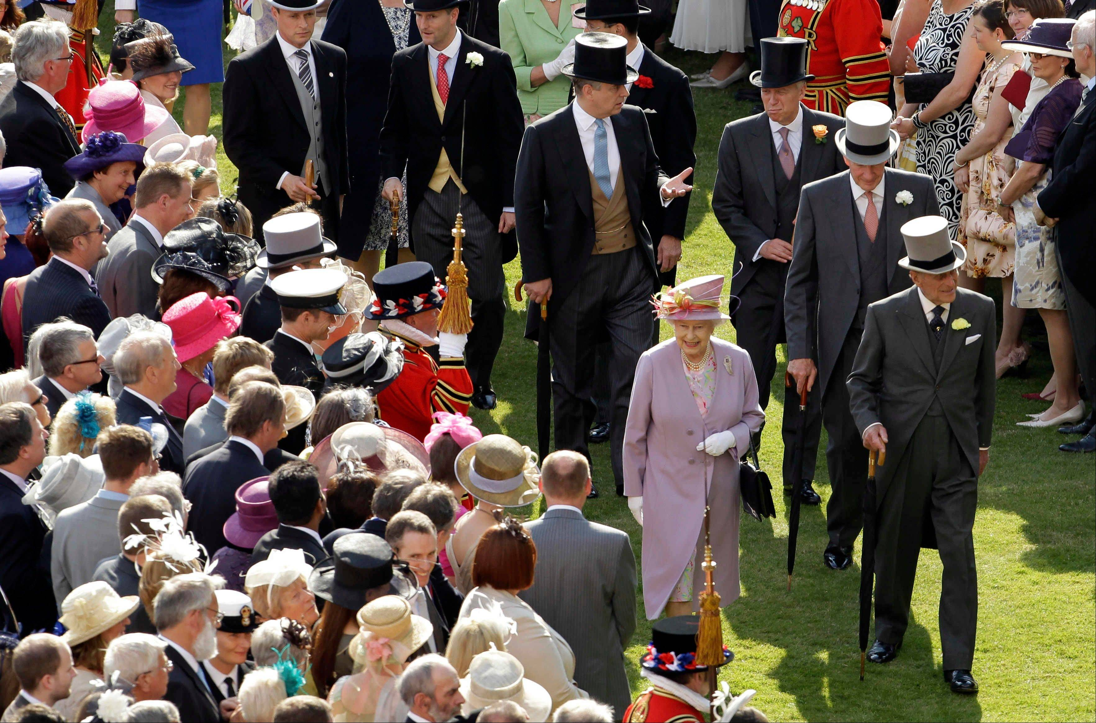 Britain�s Queen Elizabeth II walk past guests during the annual summer garden party held at Buckingham Palace in London during a typical Buckingham Palace garden party, which served around 27,000 cups of tea, 20,000 sandwiches and 20,000 slices of cake. It�s unlikely such opulence will be discontinued, despite the queen getting a pay cut.