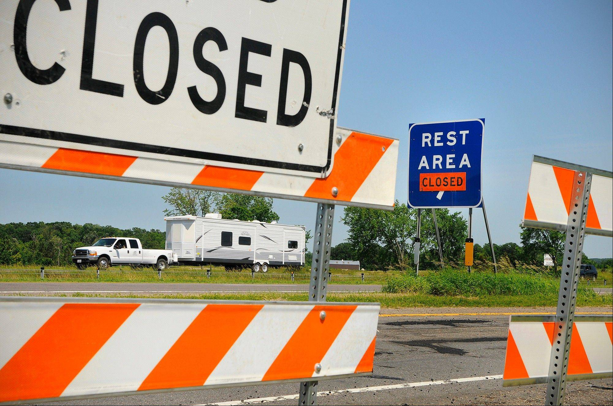 Signs are posted and barricades are out closing the rest areas on the east and west bound lanes of Interstate 94 near Avon, Minn., Wednesday, June 29, 2011. Rest areas around St. Cloud, Minn., are being closed because of the possible state shutdown.