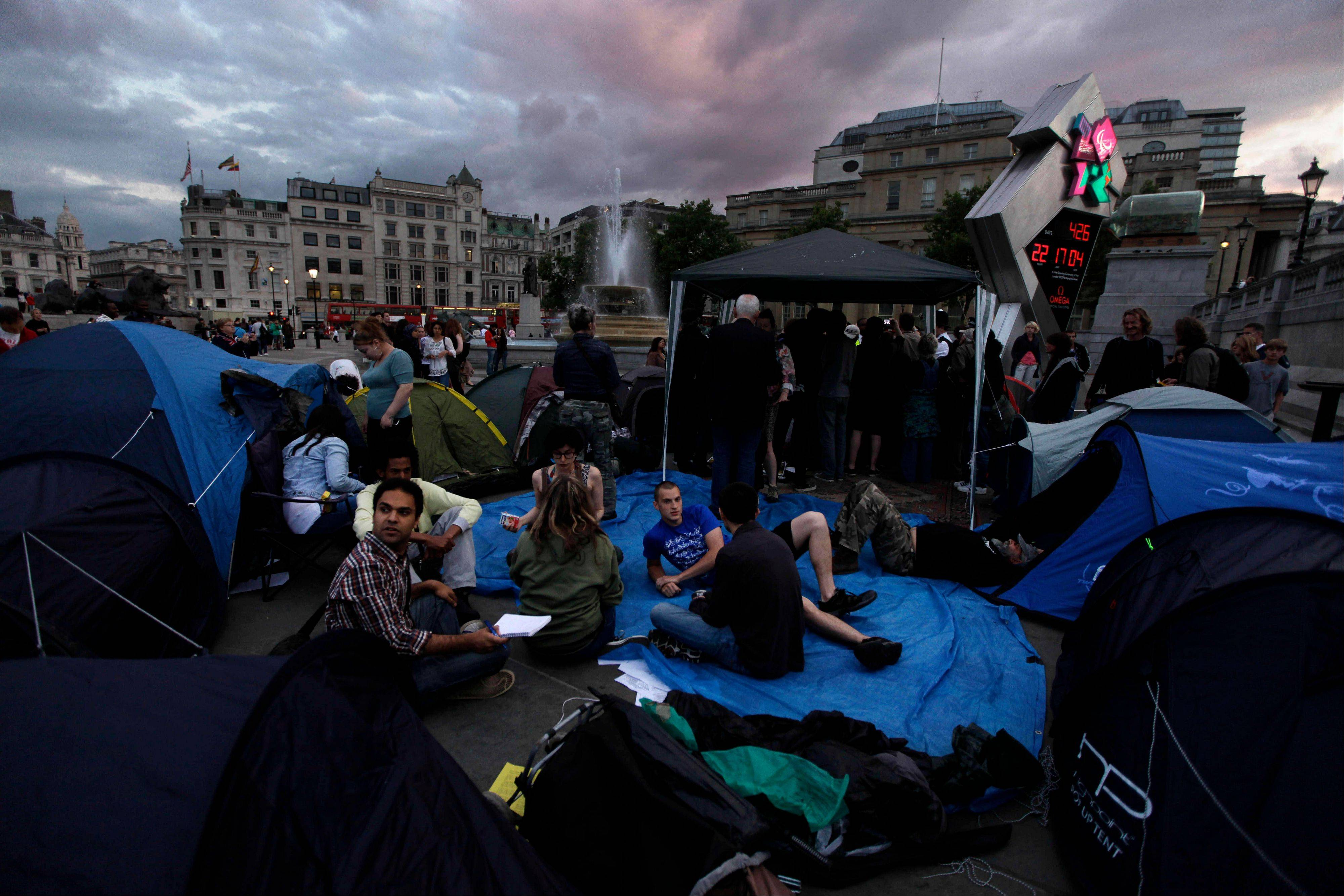 Activists sit among tents in Trafalgar Square in preparation of the strikes taking place in Britain on Thursday. Thousands of British schools will close and travelers will face long lines at airport immigration Thursday when three quarters of a million workers go on strike.