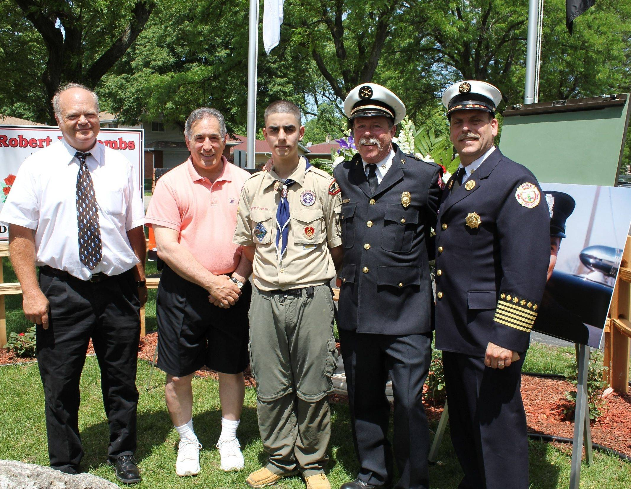 Pictured, left, Mark Coombs, son of the late Des Plaines Firefighter Robert P. Coombs; Des Plaines Mayor Martin J. Moylan; Max Jacobs, Des Plaines resident and Eagle Scout candidate, Boy Scout Troop 62; Battalion Chief Mike Bronk, North Maine Fire Protection District; and Chief Alan Wax, Des Plaines Fire Department, at the Robert P. Coombs Memorial Rose Garden dedication. Jacobs was inspired to develop the rose garden after researching a small street sign that bears Coombs� name adjacent to Fire Station No. 3.