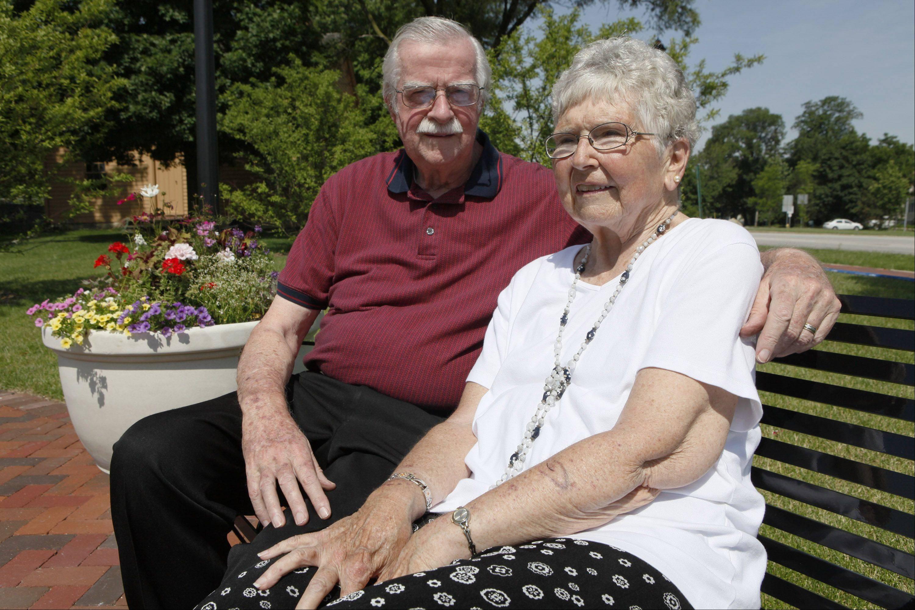 Glen Ellyn Historical Society members Doug and Ruthann Ward sit on a bench in Ward Plaza that will be dedicated in their honor on July 3. The plaza is part of the Glen Ellyn History Park, for which the Wards worked long and hard to make a reality.