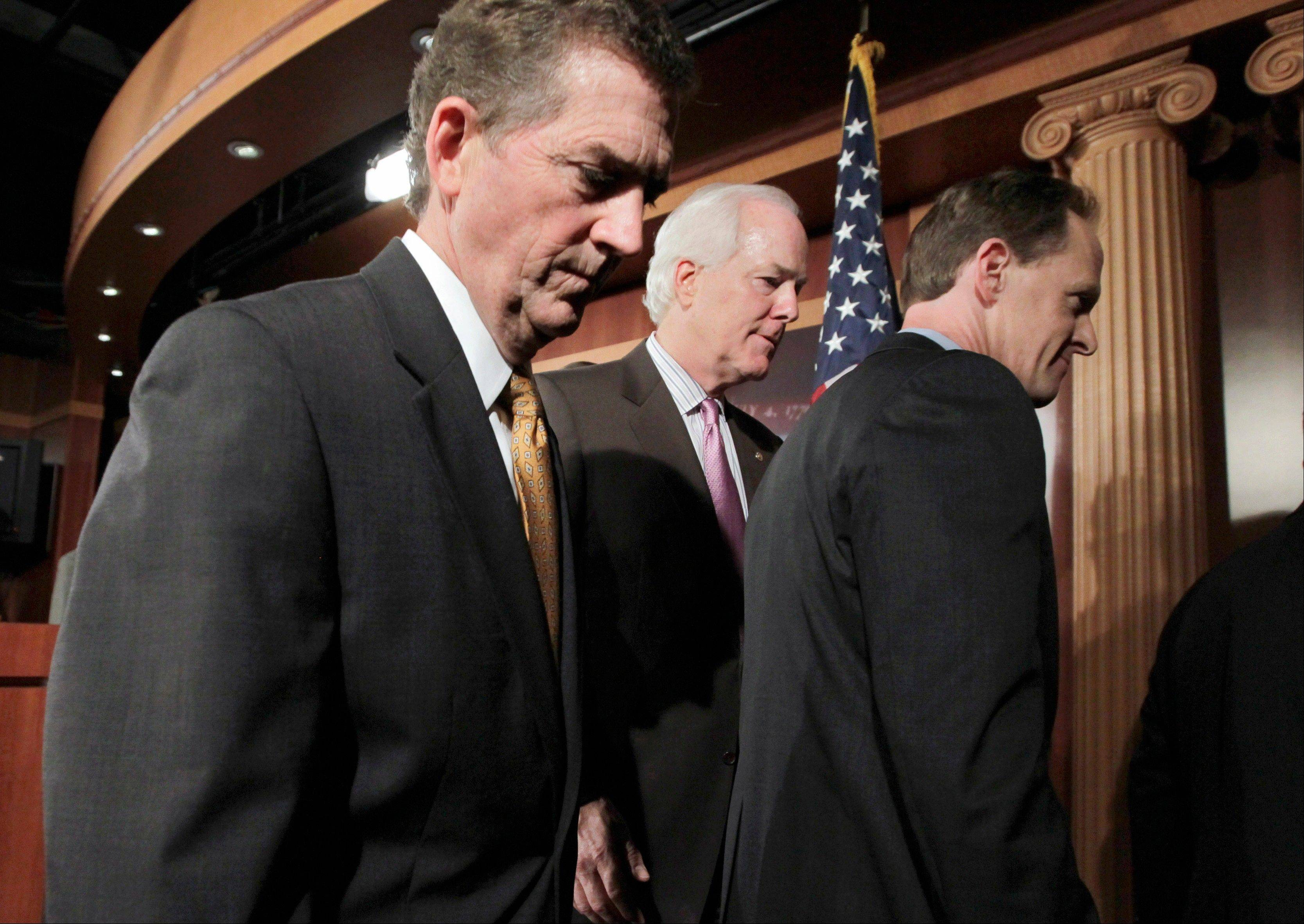 Sen. Jim DeMint, R-S.C., left, Sen. John Cornyn, R-Texas, and Sen. Pat Toomey, R-Pa., leave a news conference on Capitol Hill in Washington where they and other GOP senators said they want to forgo the holiday recess to stay in Washington and work on the debt crisis.