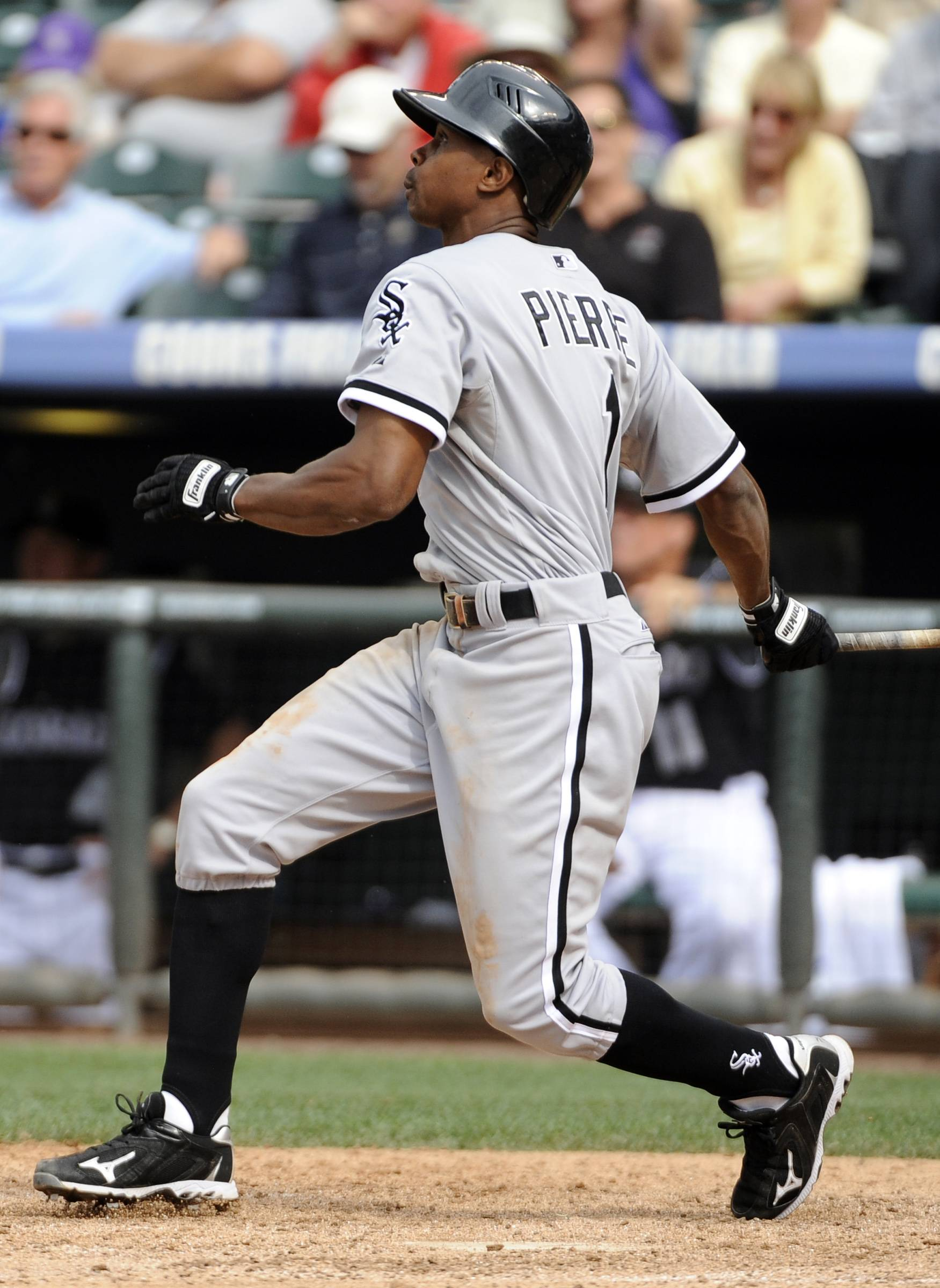 Juan Pierre hits a two-run double against the Colorado Rockies during the 10th Thursday in Denver.