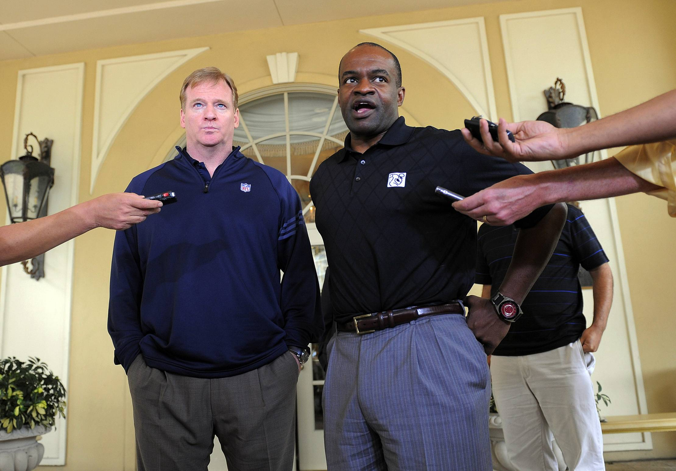 NFL commissioner Roger Goodell, left, and National Football League Players Association executive director DeMaurice Smith, right, speak to the media outside of the Ritz-Carlton hotel after addressing players during the NFLPA rookie symposium on Wednesday in Sarasota, Fla.