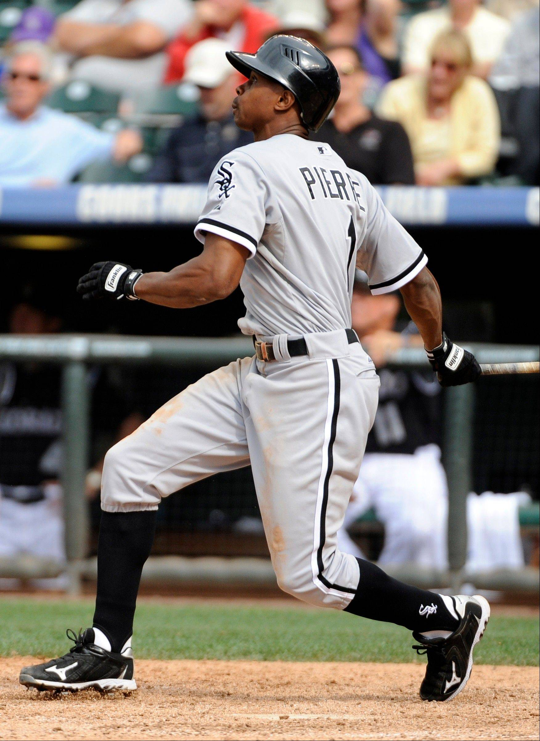 Juan Pierre hits a 2-run single in the 10th inning of the Sox' 6-4 victory over the Rockies on Thursday.