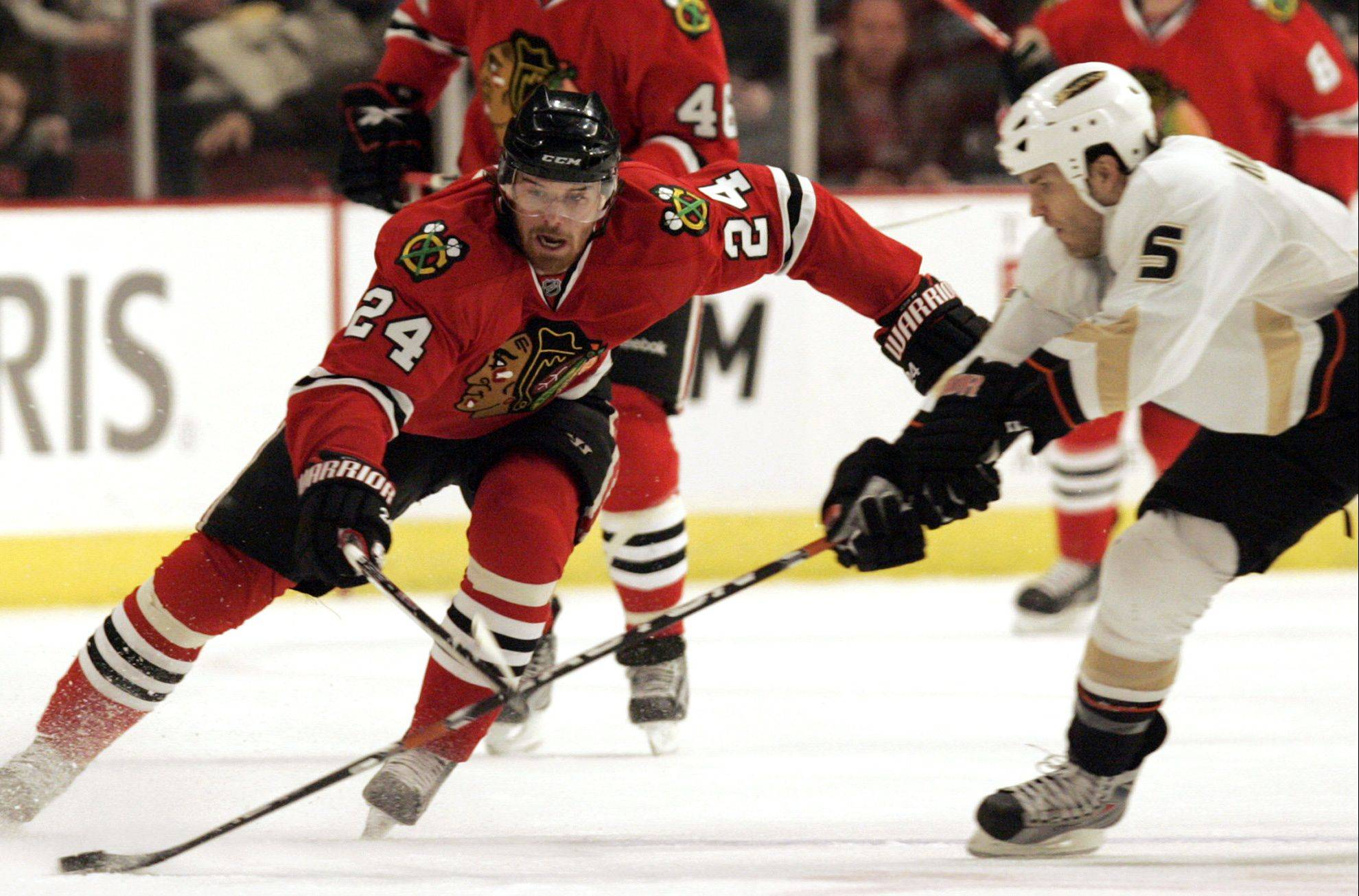 Defenseman Steve Montador, right, shown playing for the Anaheim Ducks in 2009, will join the Blackhawks this season.