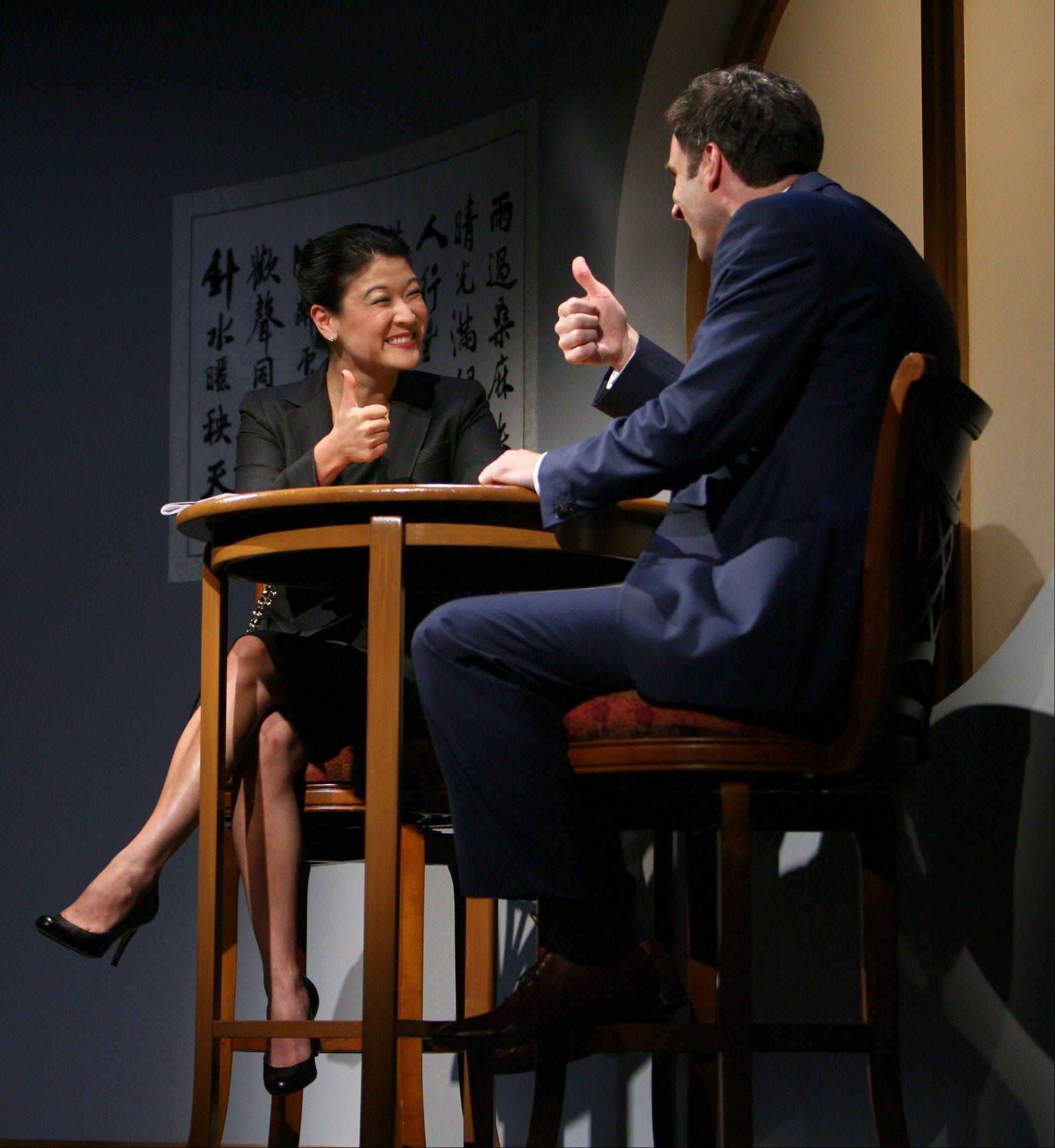 "Xu Yan (Jennifer Lim) meets with Daniel (James Waterston) to discuss his business proposal in the world premiere of David Henry Hwang's ""Chinglish"" at the Goodman Theatre in Chicago."