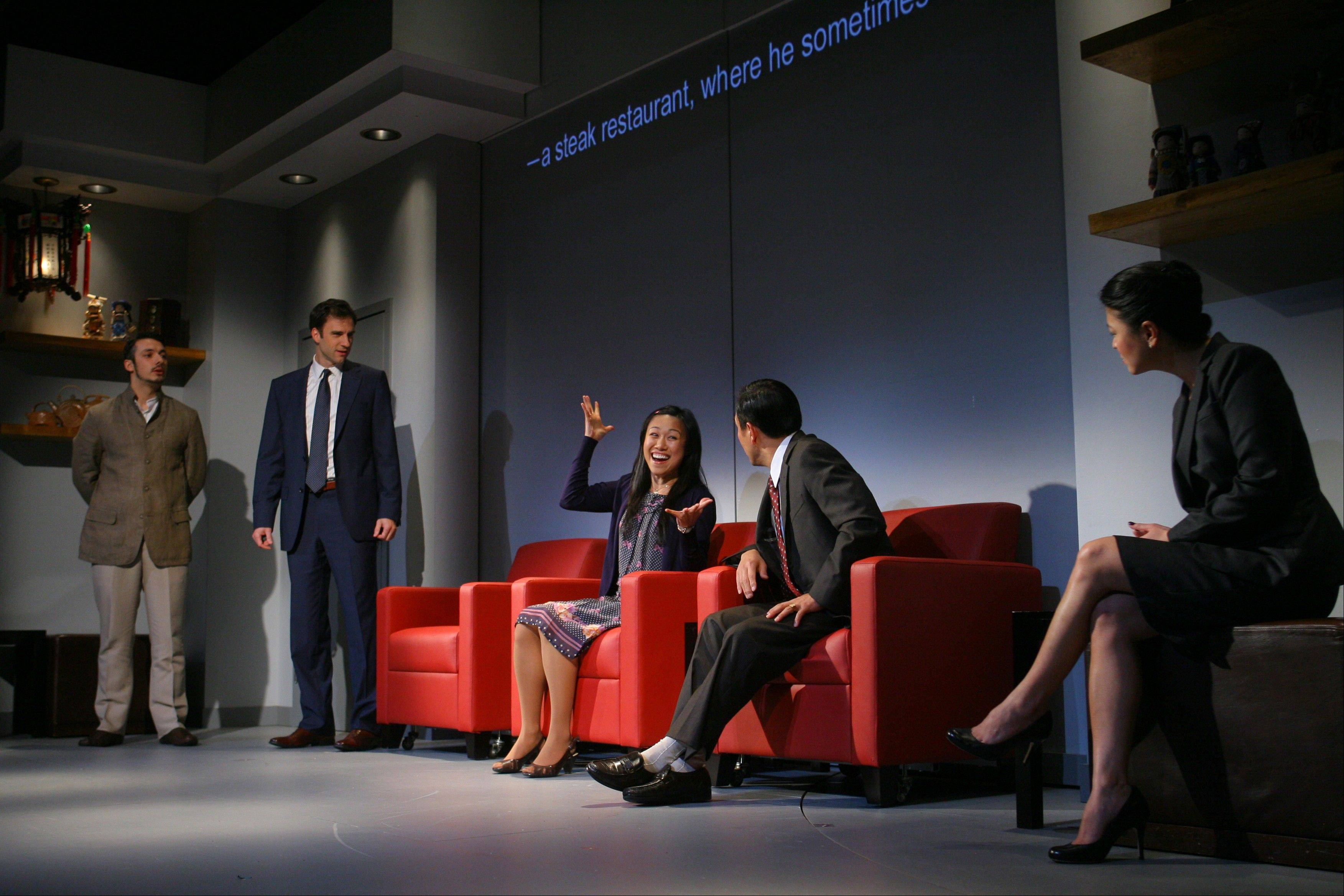 "Miss Qian (Angela Lin, center) struggles to translate a business plan between Peter (Stephen Pucci), left, Daniel (James Waterston), Minister Cai Guoliang (Larry Zhang) and Vice Minister Xu Yan (Jennifer Lim) in the world premiere of David Henry Hwang's ""Chinglish"" at the Goodman Theatre in Chicago."