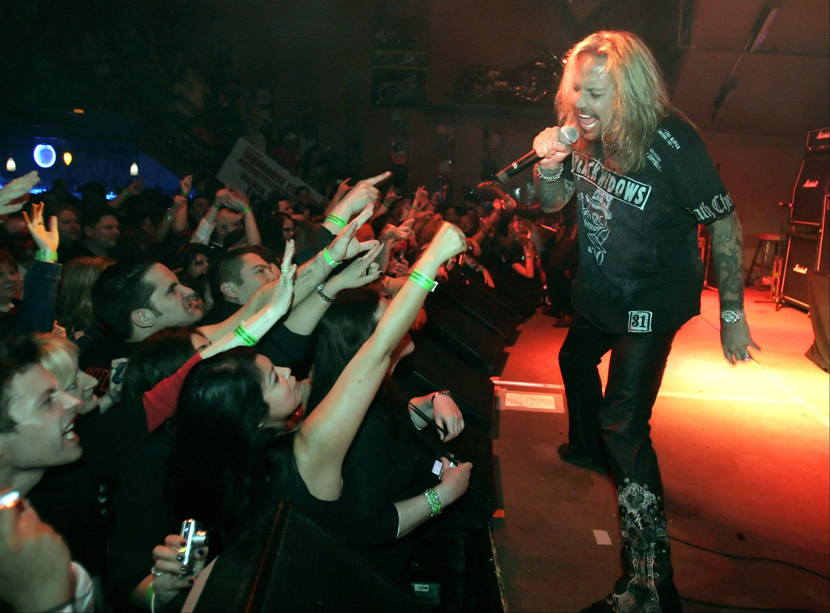 Vince Neil and Mötley Crüe share the bill with Poison and New York Dolls at the First Midwest Bank Amphitheatre in Tinley Park on Friday.